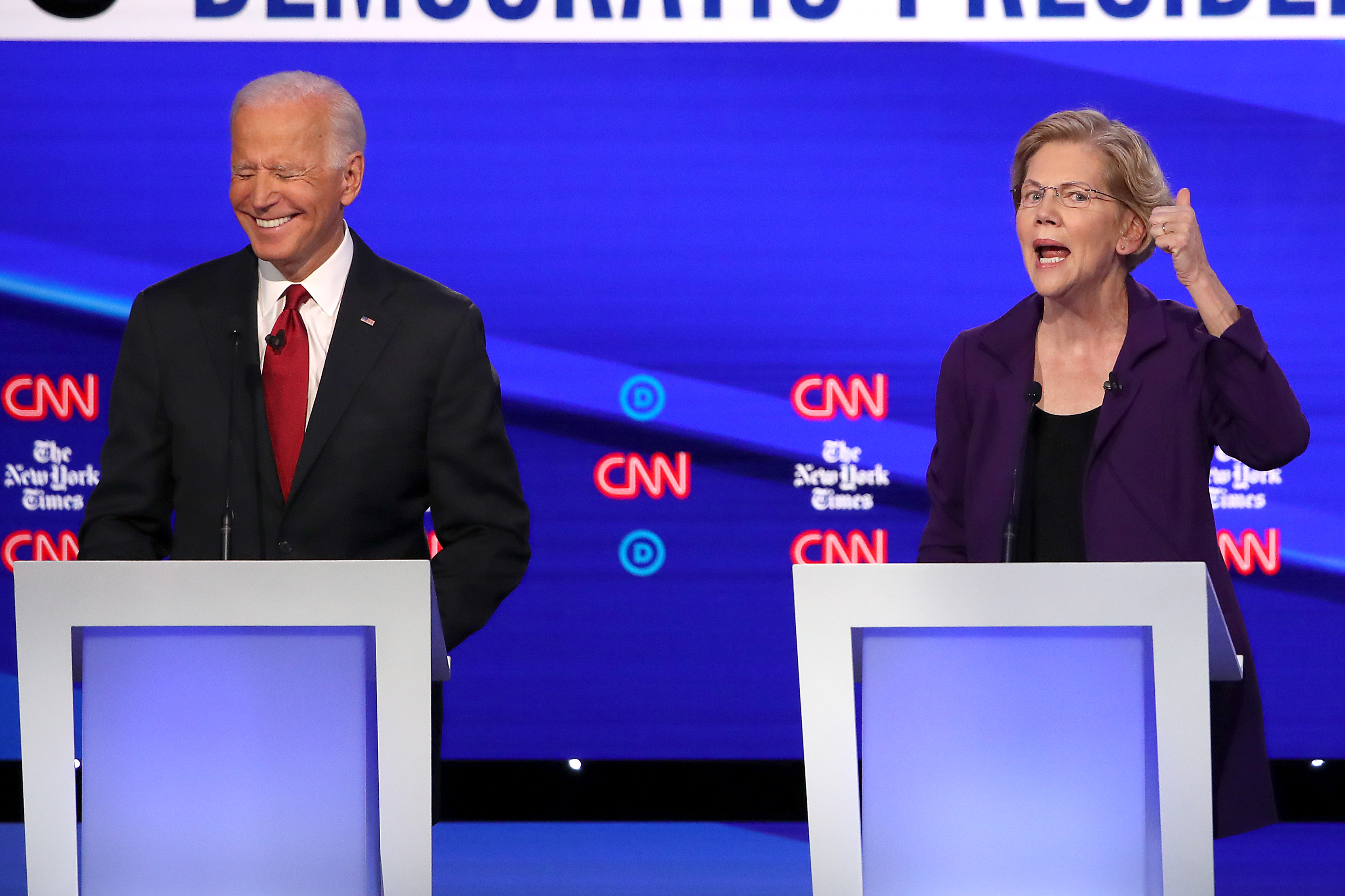 WESTERVILLE, OHIO - OCTOBER 15: Former Vice President Joe Biden and Sen. Elizabeth Warren (D-MA) react on stage during the Democratic Presidential Debate at Otterbein University on October 15, 2019 in Westerville, Ohio. A record 12 presidential hopefuls are participating in the debate hosted by CNN and The New York Times. (Photo by Win McNamee/Getty Images)