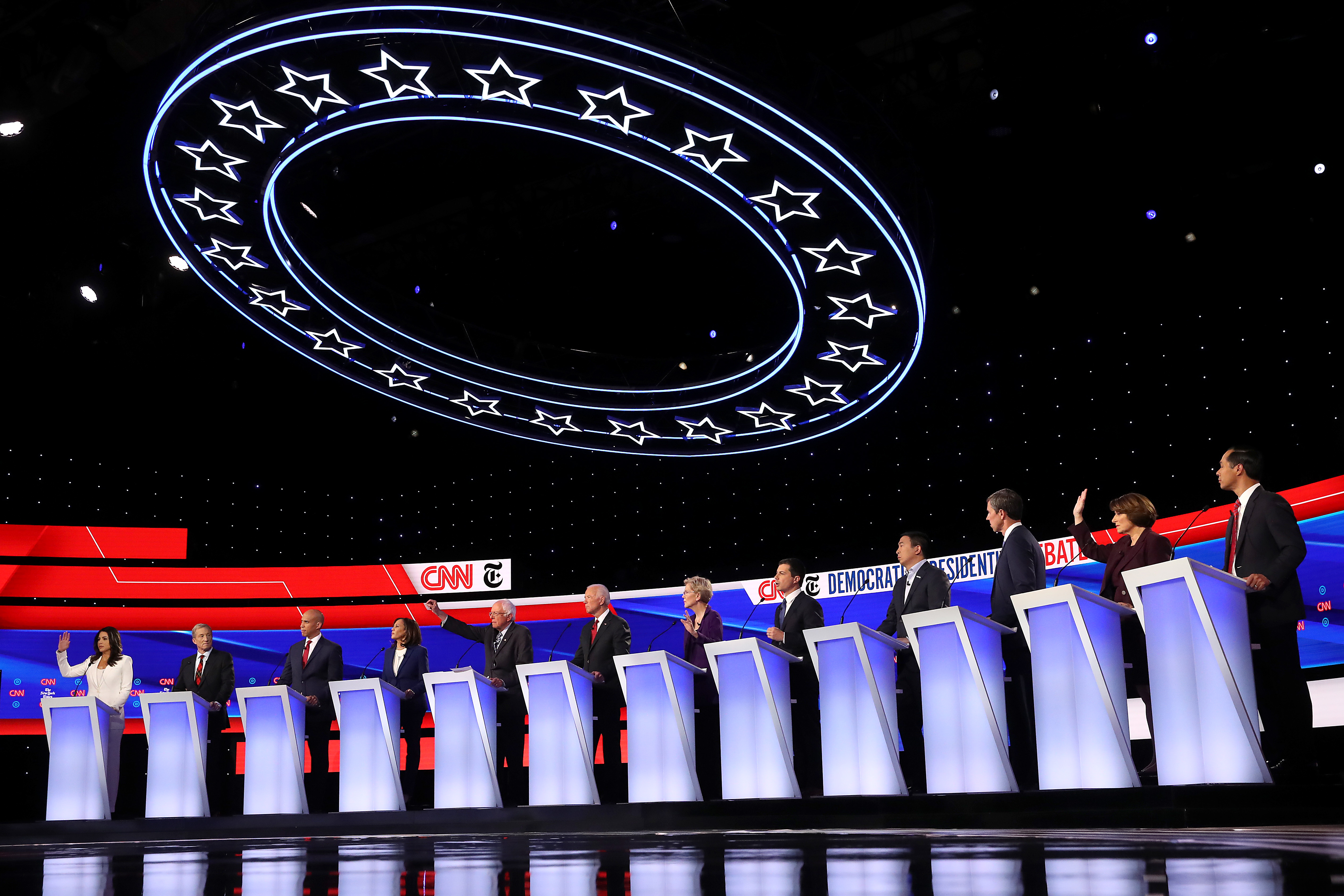 WESTERVILLE, OHIO - OCTOBER 15: Democratic presidential candidates (L-R) Rep. Tulsi Gabbard (D-HI), billionaire Tom Steyer, Sen. Cory Booker (D-NJ), Sen. Kamala Harris (D-CA), Sen. Bernie Sanders (I-VT), former Vice President Joe Biden, Sen. Elizabeth Warren (D-MA), South Bend, Indiana Mayor Pete Buttigieg, former tech executive Andrew Yang, former Texas congressman Beto O'Rourke, Sen. Amy Klobuchar (D-MN), and former housing secretary Julian Castro on stage during the Democratic Presidential Debate at Otterbein University on October 15, 2019 in Westerville, Ohio. A record 12 presidential hopefuls are participating in the debate hosted by CNN and The New York Times. (Photo by Win McNamee/Getty Images)