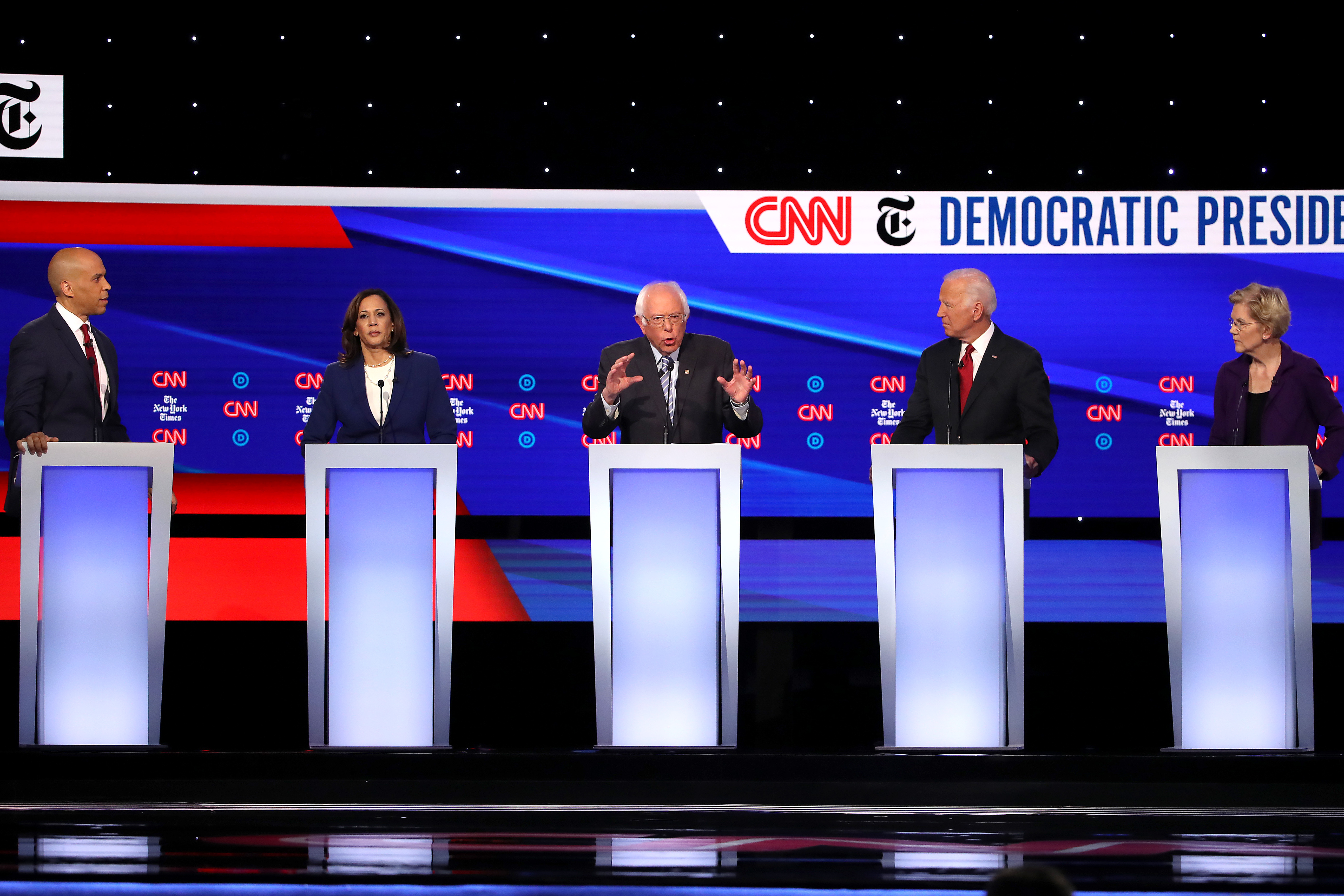 WESTERVILLE, OHIO - OCTOBER 15: Sen. Cory Booker (D-NJ), Sen. Kamala Harris (D-CA), Sen. Bernie Sanders (I-VT), former Vice President Joe Biden, and Sen. Elizabeth Warren (D-MA) interact during the Democratic Presidential Debate at Otterbein University on October 15, 2019 in Westerville, Ohio. A record 12 presidential hopefuls are participating in the debate hosted by CNN and The New York Times. (Photo by Win McNamee/Getty Images