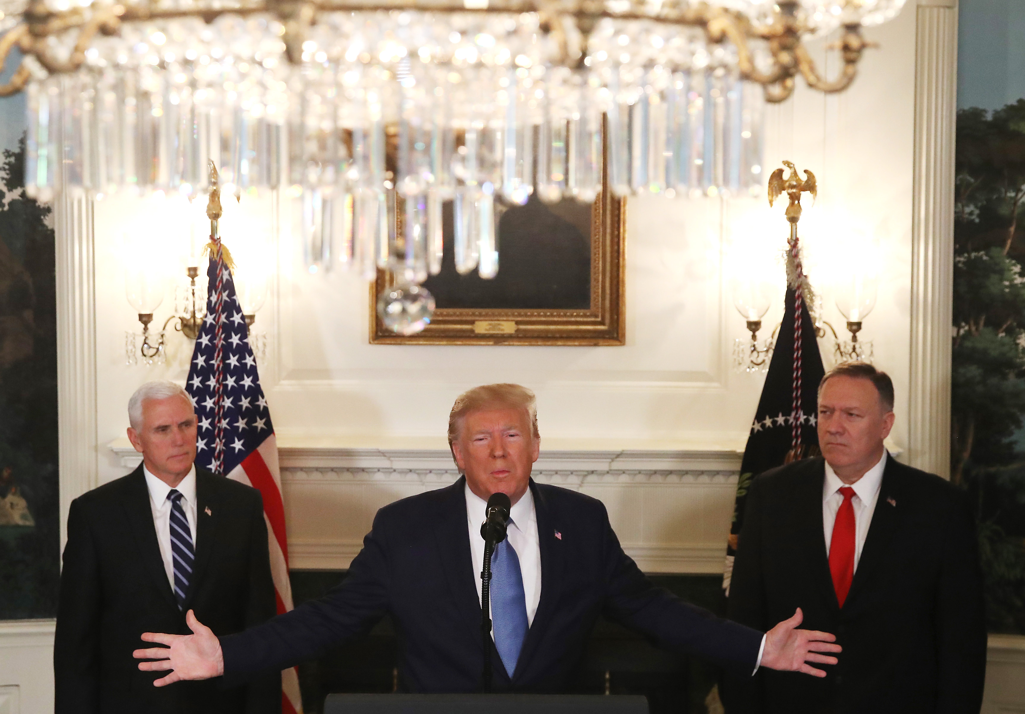 WASHINGTON, DC - OCTOBER 23: U.S. President Donald Trump is flanked by Vice President Mike Pence (L), and Secretary of State Mike Pompeo (R), while making a statement in the Diplomatic Room at the White House, on October 23, 2019 in Washington, DC. President Trump announced that the U.S. would be lifting all sanctions imposed on Turkey in response to their invasion of northern Syria. (Photo by Mark Wilson/Getty Images)