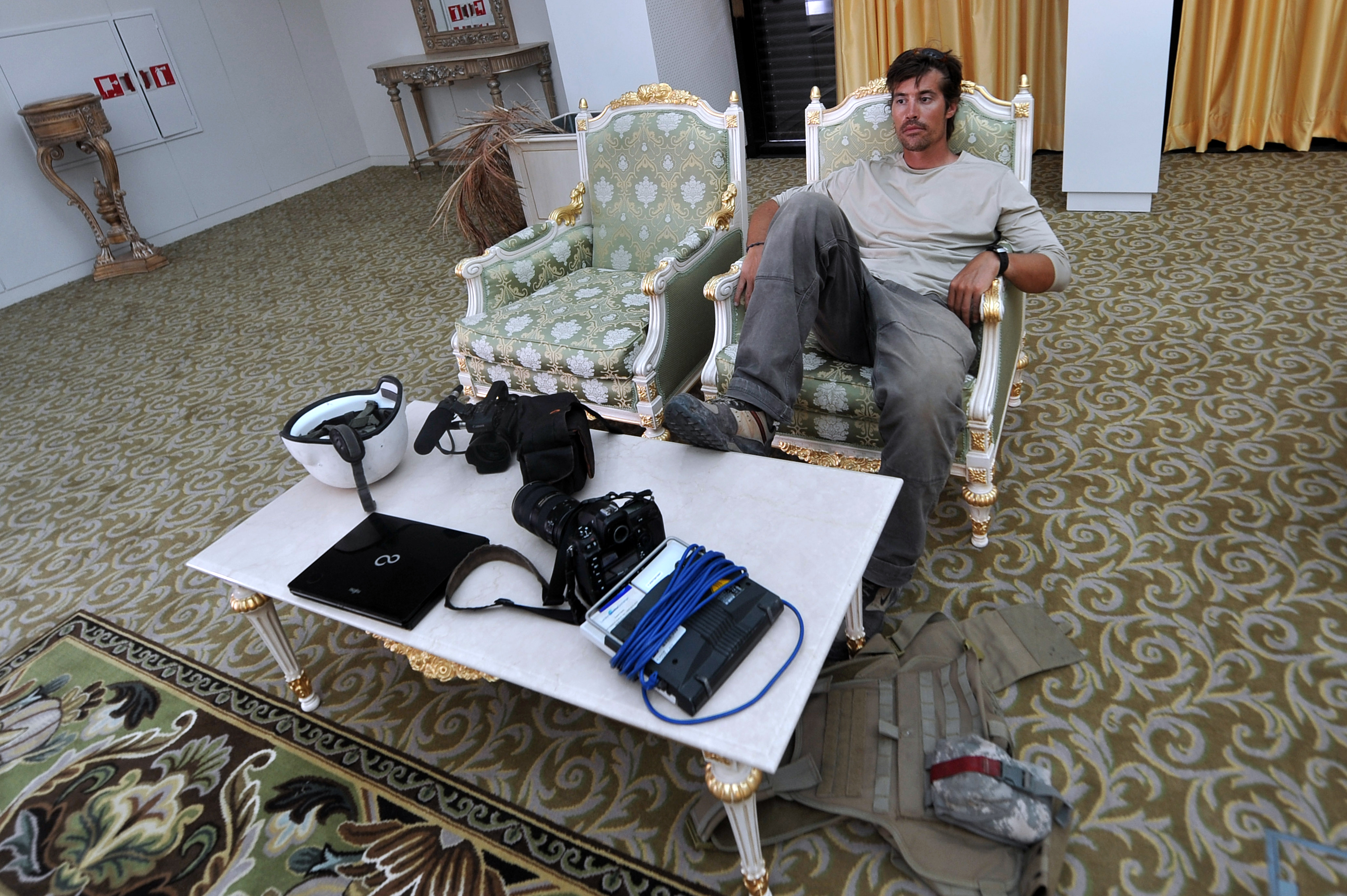 A photo taken on September 29, 2011 shows US freelance reporter James Foley resting in a room at the airport of Sirte, Libya. (ARIS MESSINIS/AFP/Getty Images)