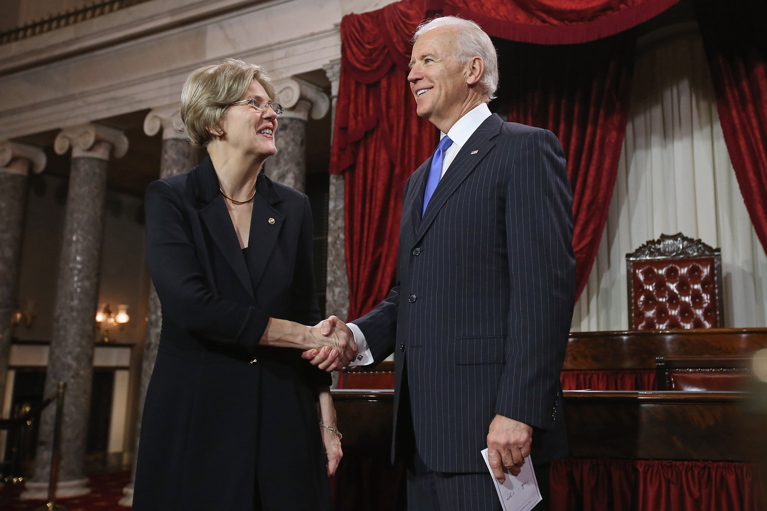 WASHINGTON, DC - JANUARY 03: U.S. Sen. Elizabeth Warren (D-MA) (L) participates in a reenacted swearing-in with U.S. Vice President Joe Biden in the Old Senate Chamber at the U.S. Capitol January 3, 2013 in Washington, DC. Biden swore in the newly-elected and re-elected senators earlier in the day on the floor of the current Senate chamber. (Photo by Chip Somodevilla/Getty Images)