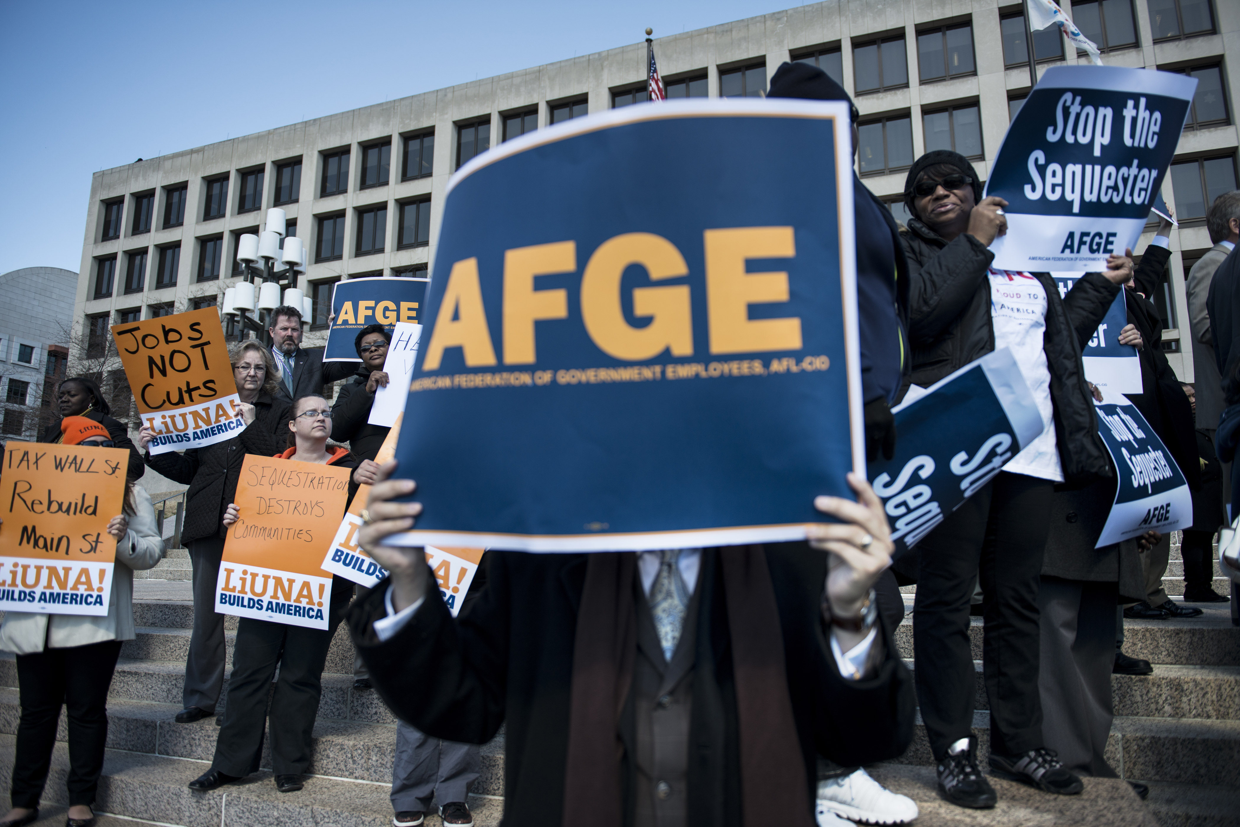 Members of the American Federation of Government Employees(AFGE) and members Laborers International Union of North America(LiUNA) gather during a rally on outside the Department of Labor on March 20, 2013 in Washington, DC. The demonstrators gathered to protest the effects of the government sequester. AFP PHOTO/Brendan SMIALOWSKI (Photo credit should read BRENDAN SMIALOWSKI/AFP via Getty Images)