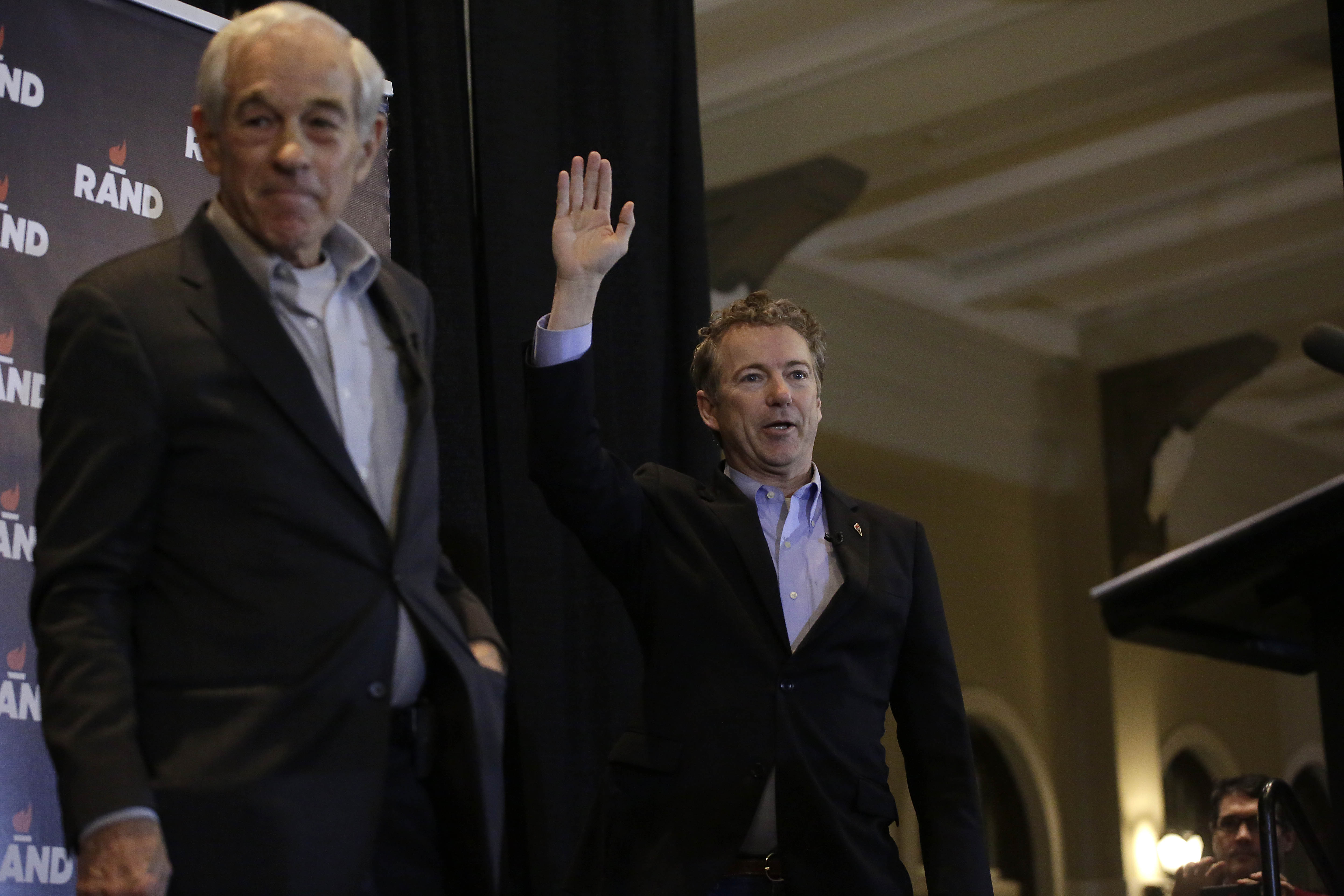 IOWA CITY, IA - JANUARY 31 : Republican presidential candidate, U.S. Sen. Rand Paul (R-KY) waves as he is introduced by his father Ron Paul, former U.S. Representative from Texas during a campaign event at the University of Iowa Memorial Union January 31, 2016 in Iowa City, Iowa. Paul who is seeking the nomination for the Republican Party is on the presidential campaign trail across Iowa ahead of the Iowa Caucus taking place Monday, a week before the New Hampshire Primaries. (Photo by Joshua Lott/Getty Images)