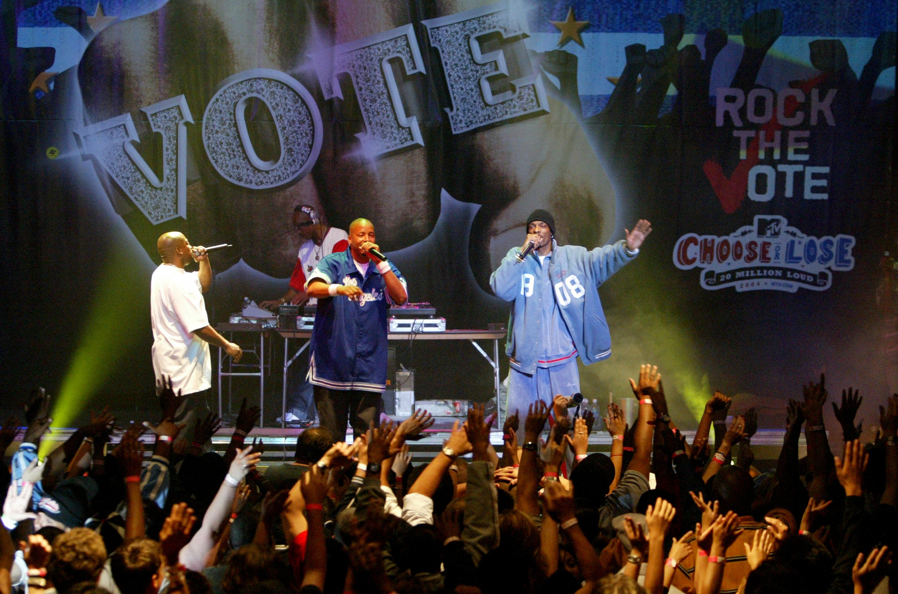 HOLLYWOOD - JUNE 16: (US TABS AND HOLLYWOOD REPORTER OUT) Members of 213, Nate Dogg, Warren G and Snoop Dogg perform during the Rock The Vote Bus Tour Launch Concert on June 16, 2004 at the Avalon in Hollywood, California. (Photo by Vince Bucci/Getty Images)