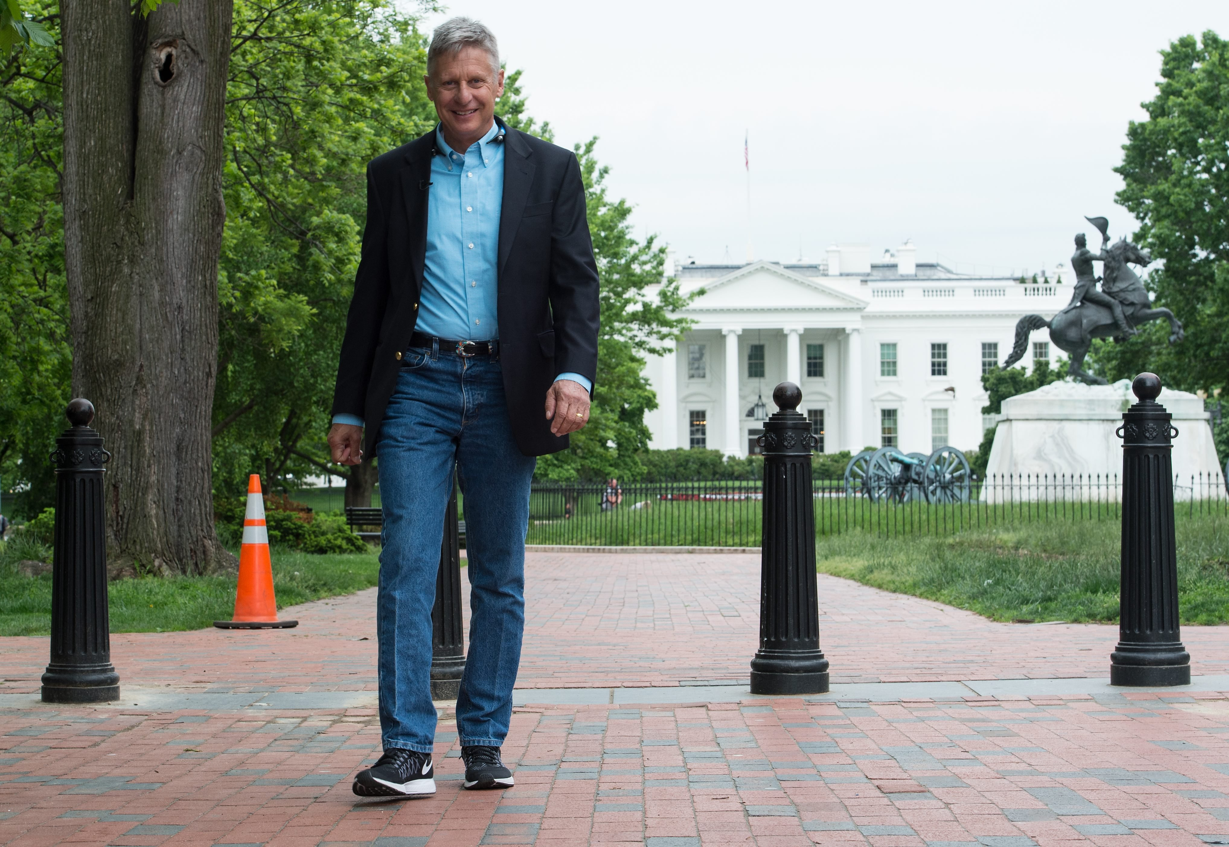 US Libertarian Party presidential candidate Gary Johnson walks in Lafayette Park across from the White House during an interview with AFP in Washington, DC, on May 9, 2016. Former New Mexico Gov. Gary Johnson is running for president as a Libertarian, just as he did 2012 when he managed to get 1.2 million votes. Regardless of his chances of a win, Johnson is reaching out to undecided Republican voters who are looking for a third-party option and are unconvinced that Donald Trump is the answer. / AFP / Nicholas KAMM (Photo credit should read NICHOLAS KAMM/AFP/Getty Images)