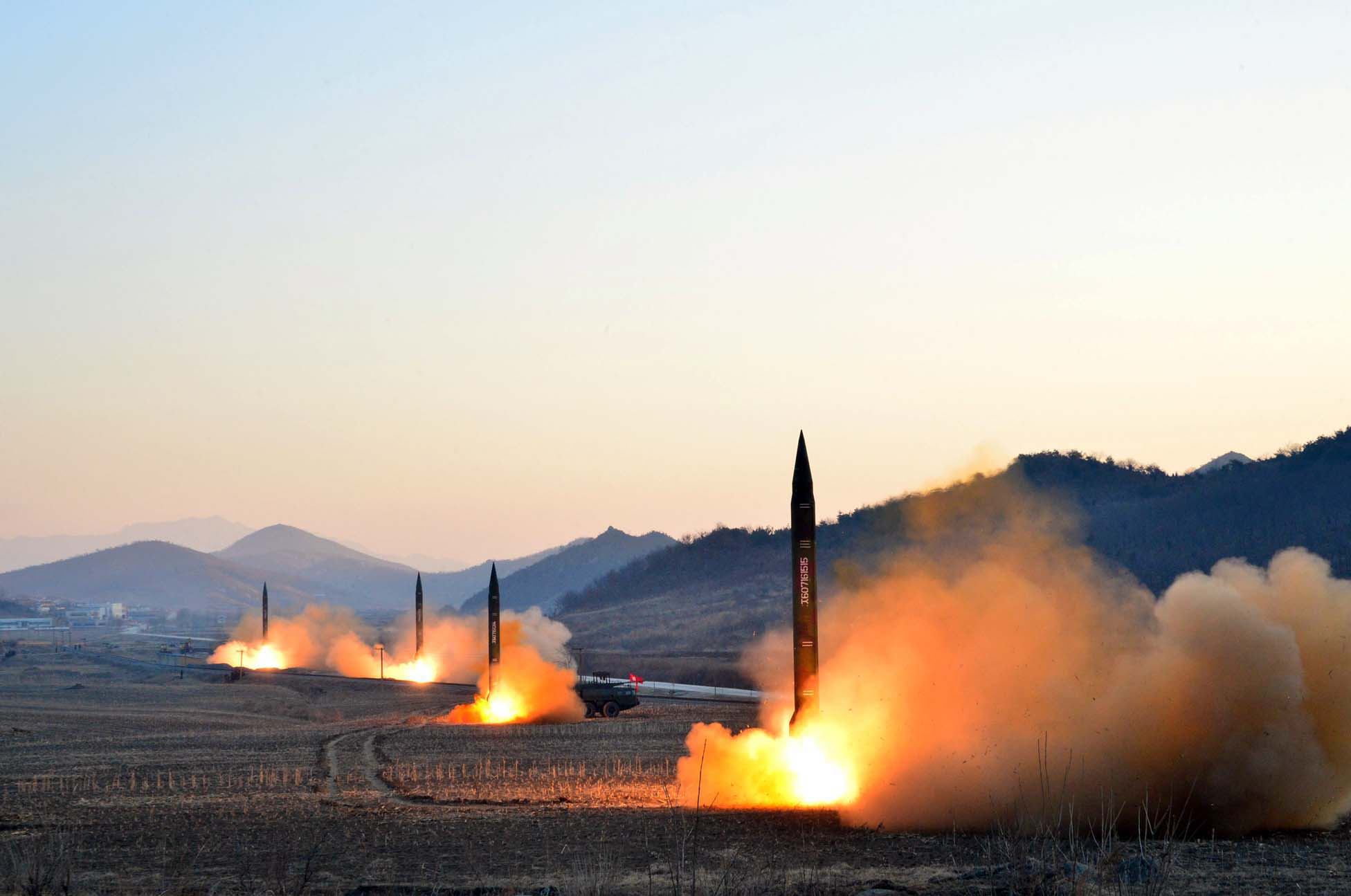 This undated picture released by North Korea's Korean Central News Agency (KCNA) via KNS on March 7, 2017 shows the launch of four ballistic missiles by the Korean People's Army (KPA) during a military drill at an undisclosed location in North Korea. Nuclear-armed North Korea launched four ballistic missiles on March 6 in another challenge to President Donald Trump, with three landing provocatively close to America's ally Japan. / AFP PHOTO / KCNA VIA KNS / STR / South Korea OUT / REPUBLIC OF KOREA OUT ---EDITORS NOTE--- RESTRICTED TO EDITORIAL USE - MANDATORY CREDIT