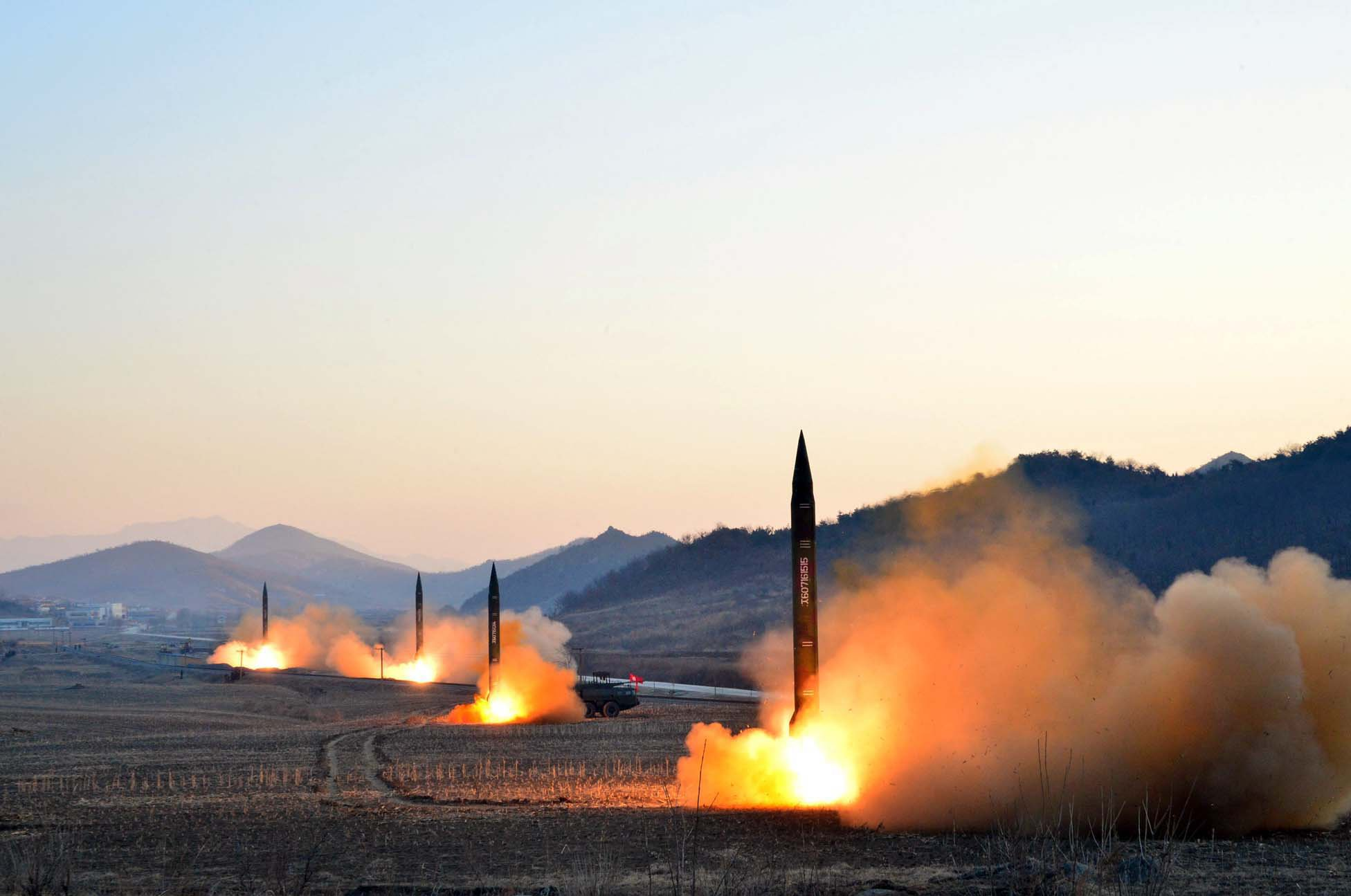 "This undated picture released by North Korea's Korean Central News Agency (KCNA) via KNS on March 7, 2017 shows the launch of four ballistic missiles by the Korean People's Army (KPA) during a military drill at an undisclosed location in North Korea. Nuclear-armed North Korea launched four ballistic missiles on March 6 in another challenge to President Donald Trump, with three landing provocatively close to America's ally Japan. / AFP PHOTO / KCNA VIA KNS / STR / South Korea OUT / REPUBLIC OF KOREA OUT ---EDITORS NOTE--- RESTRICTED TO EDITORIAL USE - MANDATORY CREDIT ""AFP PHOTO/KCNA VIA KNS"" - NO MARKETING NO ADVERTISING CAMPAIGNS - DISTRIBUTED AS A SERVICE TO CLIENTS THIS PICTURE WAS MADE AVAILABLE BY A THIRD PARTY. AFP CAN NOT INDEPENDENTLY VERIFY THE AUTHENTICITY, LOCATION, DATE AND CONTENT OF THIS IMAGE. THIS PHOTO IS DISTRIBUTED EXACTLY AS RECEIVED BY AFP. / (Photo credit should read STR/AFP/Getty Images)"