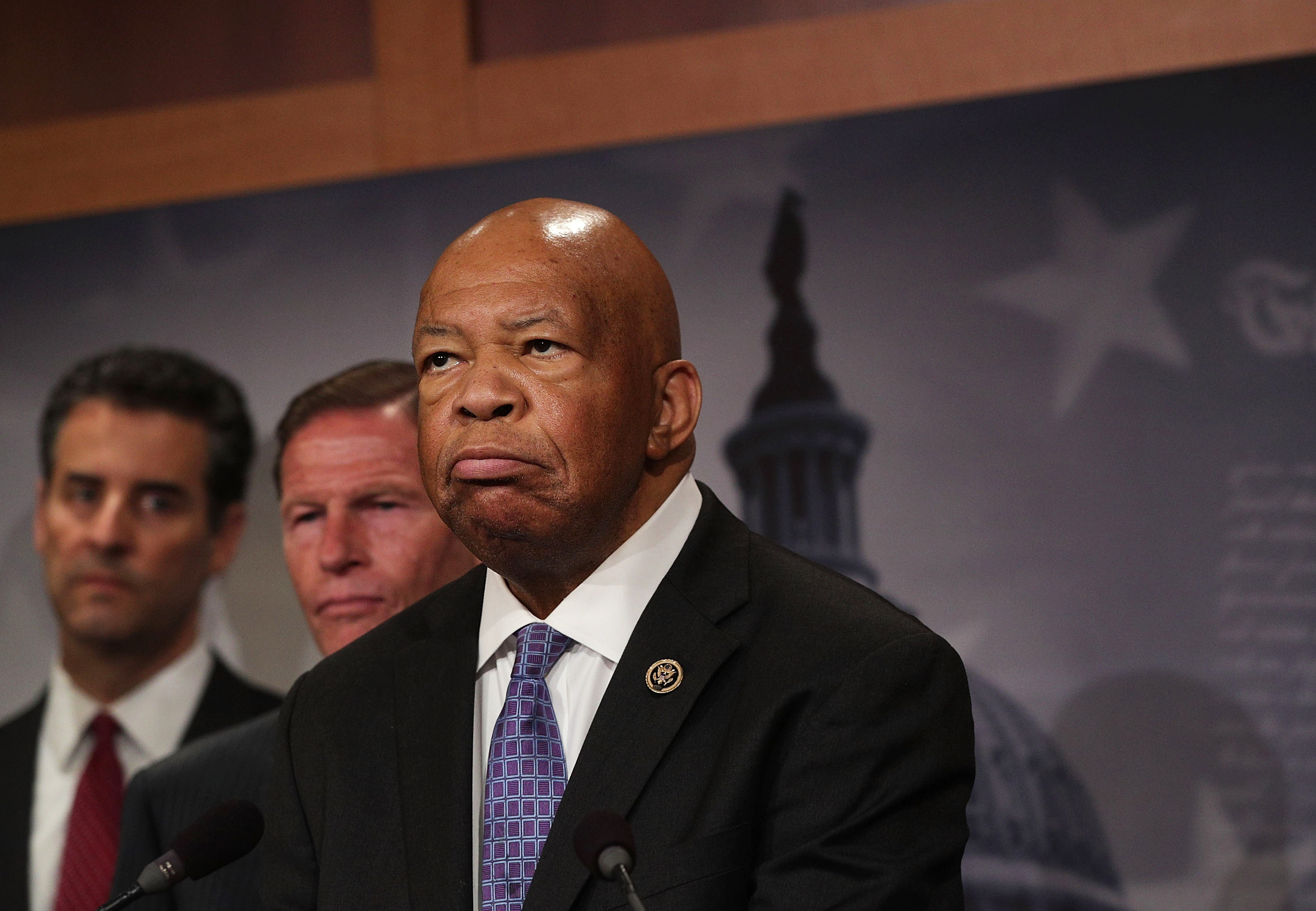 U.S. Rep. Elijah Cummings (D-MD) (R) pauses as Rep. John Sarbanes (D-MD) (L) and Sen. Richard Blumenthal (D-CT) (2nd L) look on during a news conference at the Capitol. (Alex Wong/Getty Images)