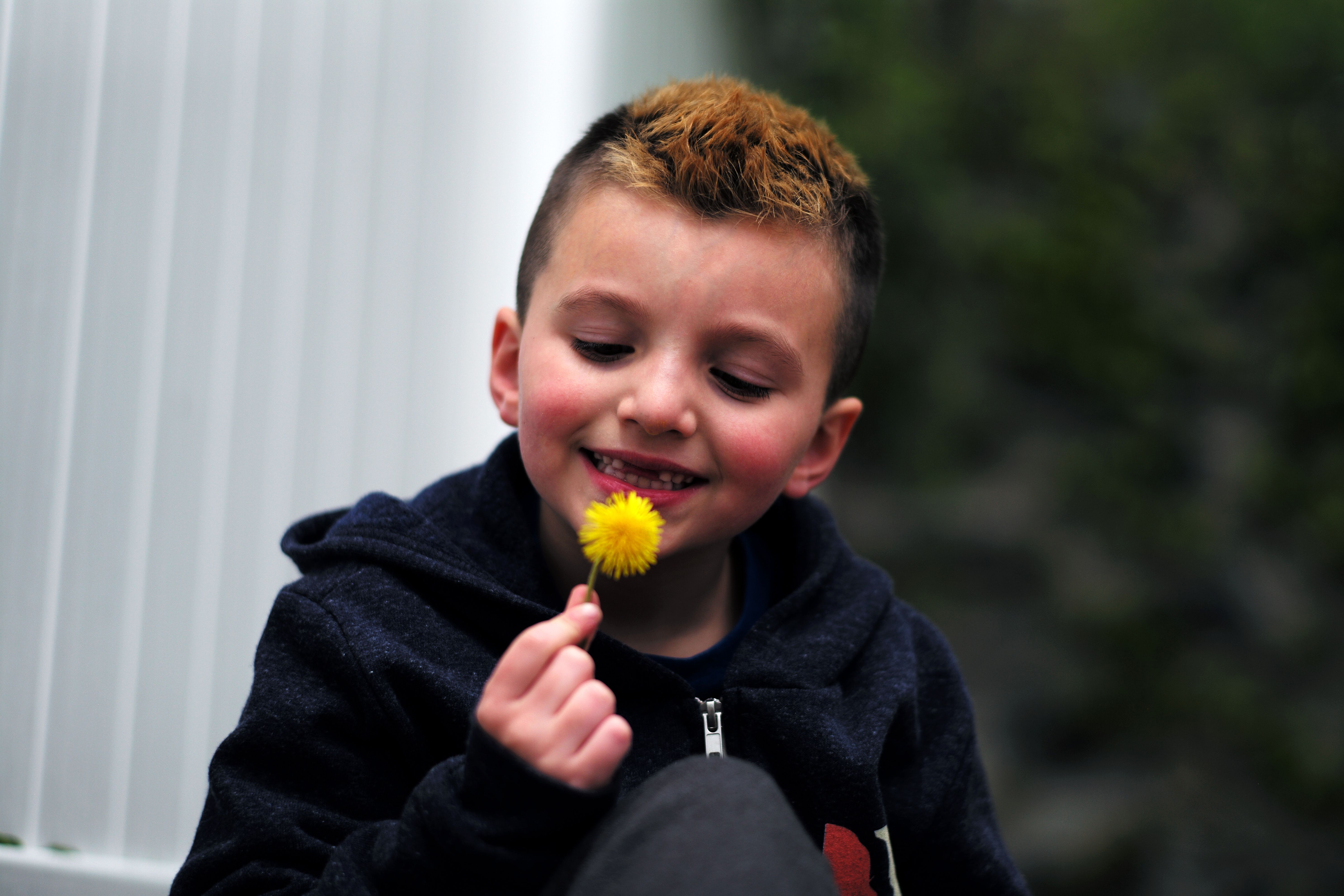 """Seven-year-old transgender boy Jacob Lemay poses for photos in the yard of his home in Melrose, Massachusetts, on May 9, 2017. For months in the Lemay home, the same phrase was repeated over and over by their troubled young child, barely more than a toddler, who showed growing signs of depression. """"It is a mistake, I am not a girl, I am a boy."""" That convinced the Lemay family that Mia should become Jacob. / AFP PHOTO / JEWEL SAMAD"""