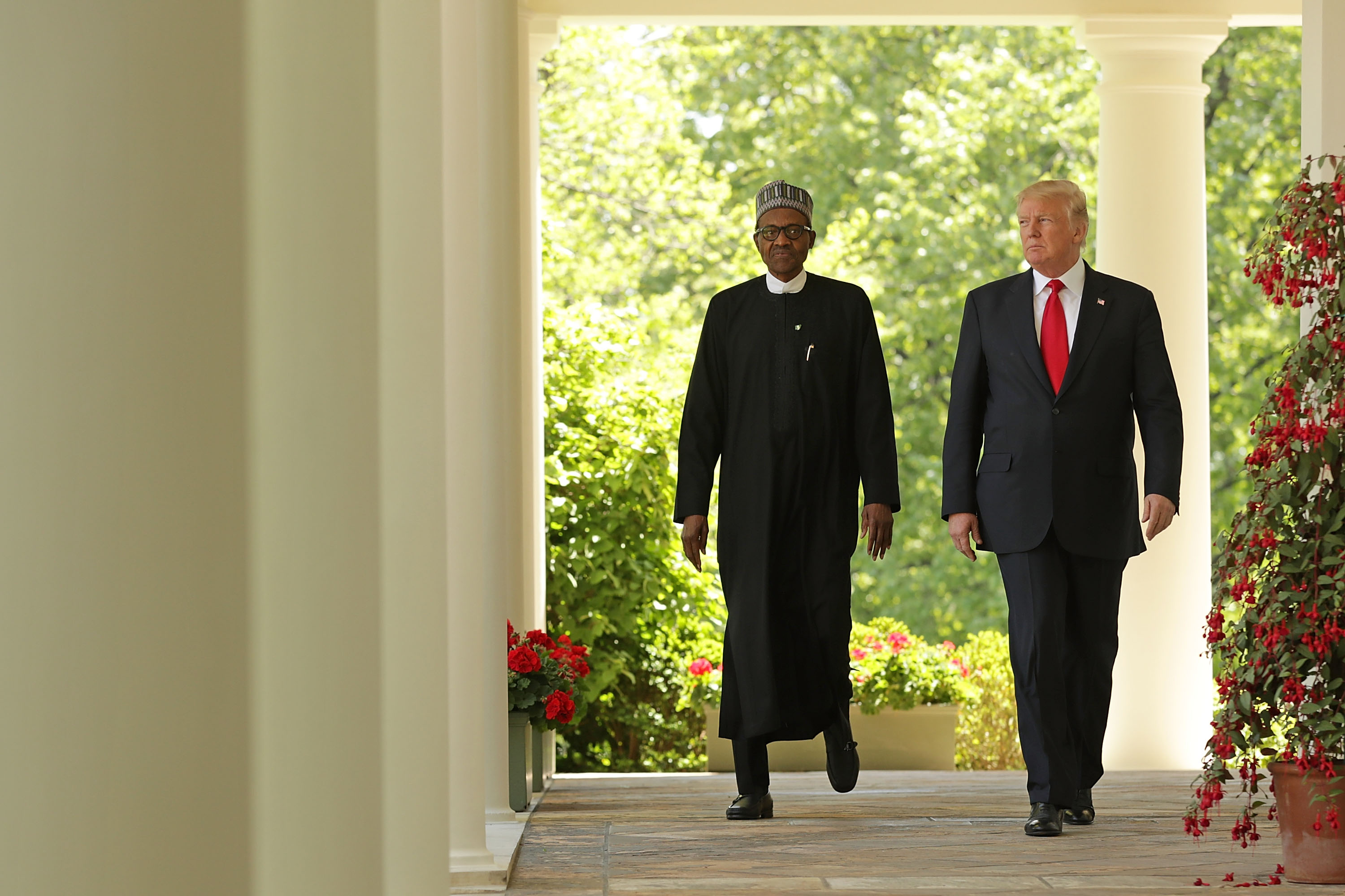WASHINGTON, DC - APRIL 30: U.S. President Donald Trump (R) and Nigerian President Muhammadu Buhari walk into the Rose Garden for a joint press conference at the White House April 30, 2018 in Washington, DC. The two leaders also met in the Oval Office to discuss a range of bilateral issues earlier in the day. (Photo by Chip Somodevilla/Getty Images)