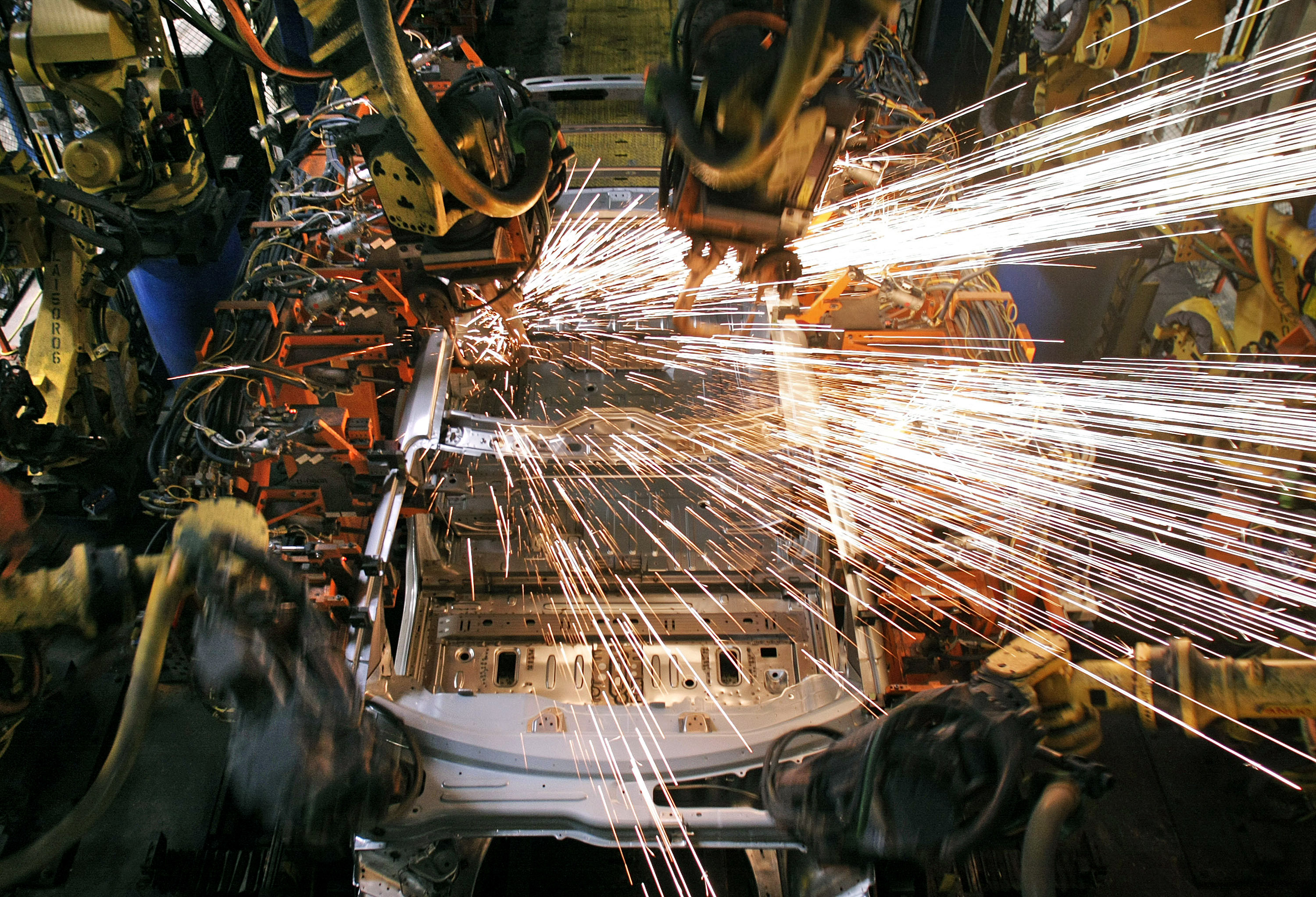 LANSING, MI - MARCH 10: A vehicle is welded by robot arms as it goes through the assembly line at the General Motors Lansing Delta Township Assembly Plant March 10, 2010 in Lansing, Michigan. The Delta plant has more than 3,000 workers on two shifts and is expected to add a third shift of 900-1,000 workers in April. The plant produces the Buick Enclave, Chevrolet Traverse, and GMC Acadia crossover SUVs. (Photo by Bill Pugliano/Getty Images)