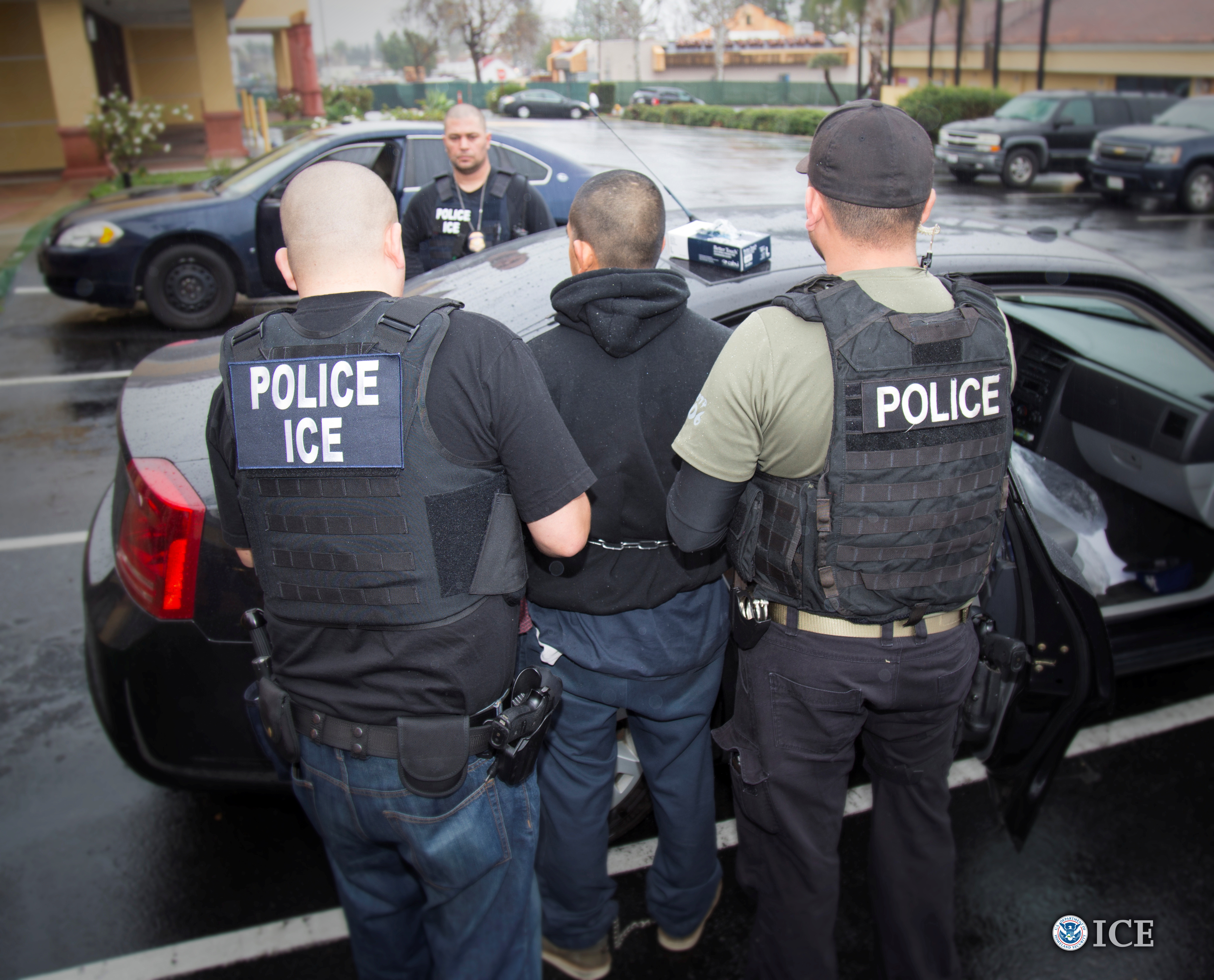 ICE officers detain a suspect as they conduct a targeted enforcement operation in Los Angeles