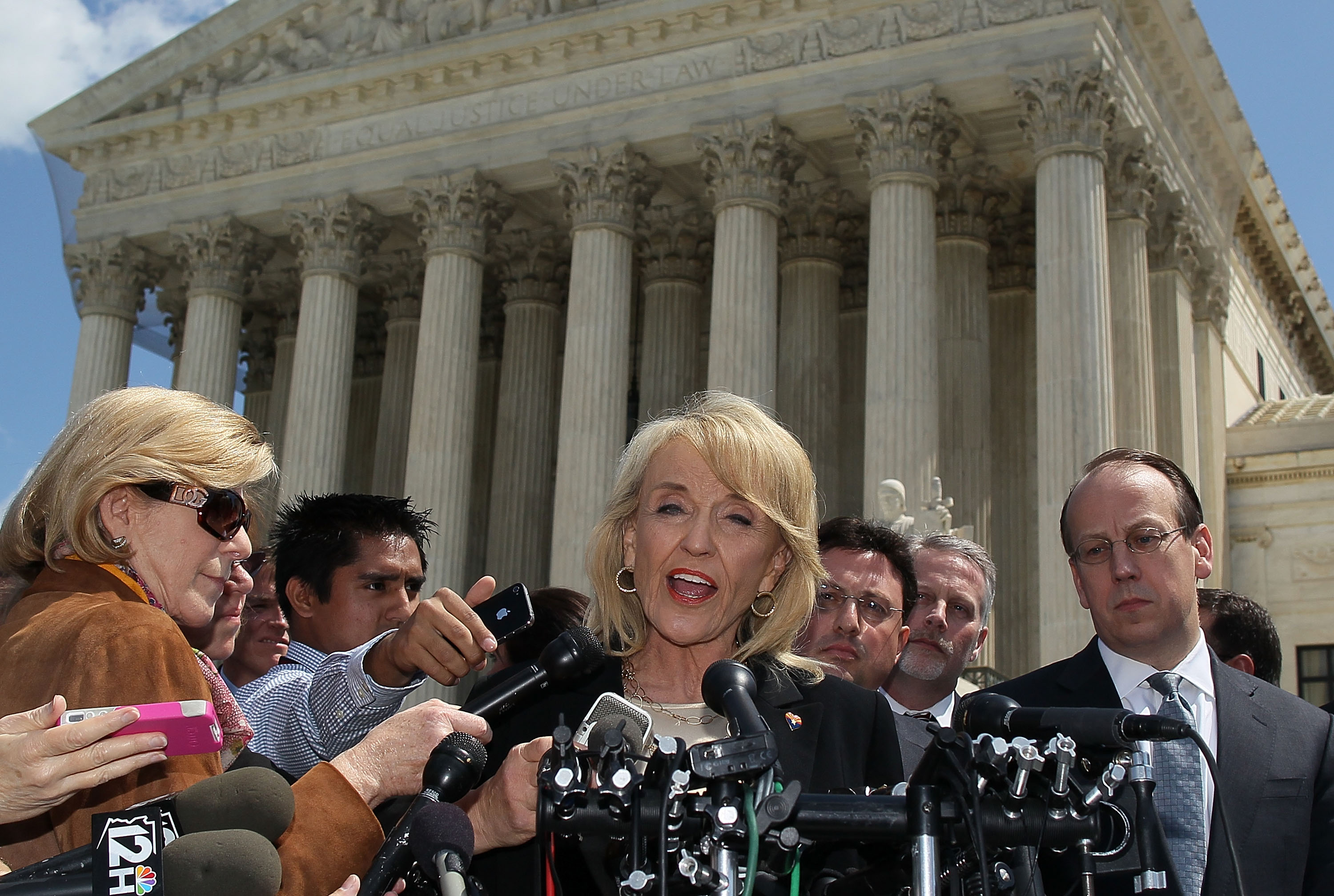 Former Arizona Gov. Jan Brewer speaks to the media after arguments in Arizona v. United States on April 25, 2012 at the Supreme Court. (Mark Wilson/Getty Images)