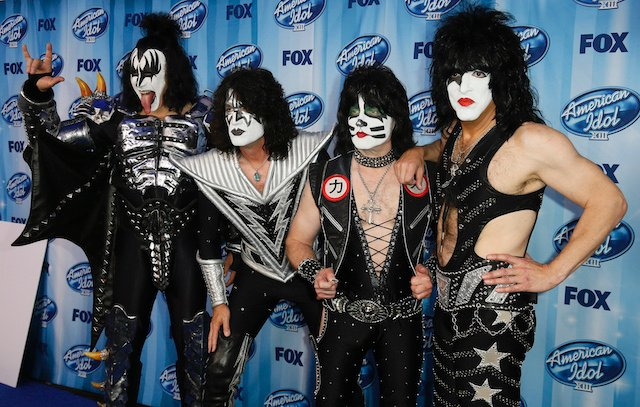 The band Kiss poses backstage at the American Idol XIII 2014 Finale in Los Angeles, California May 21, 2014. REUTERS/Danny Moloshok