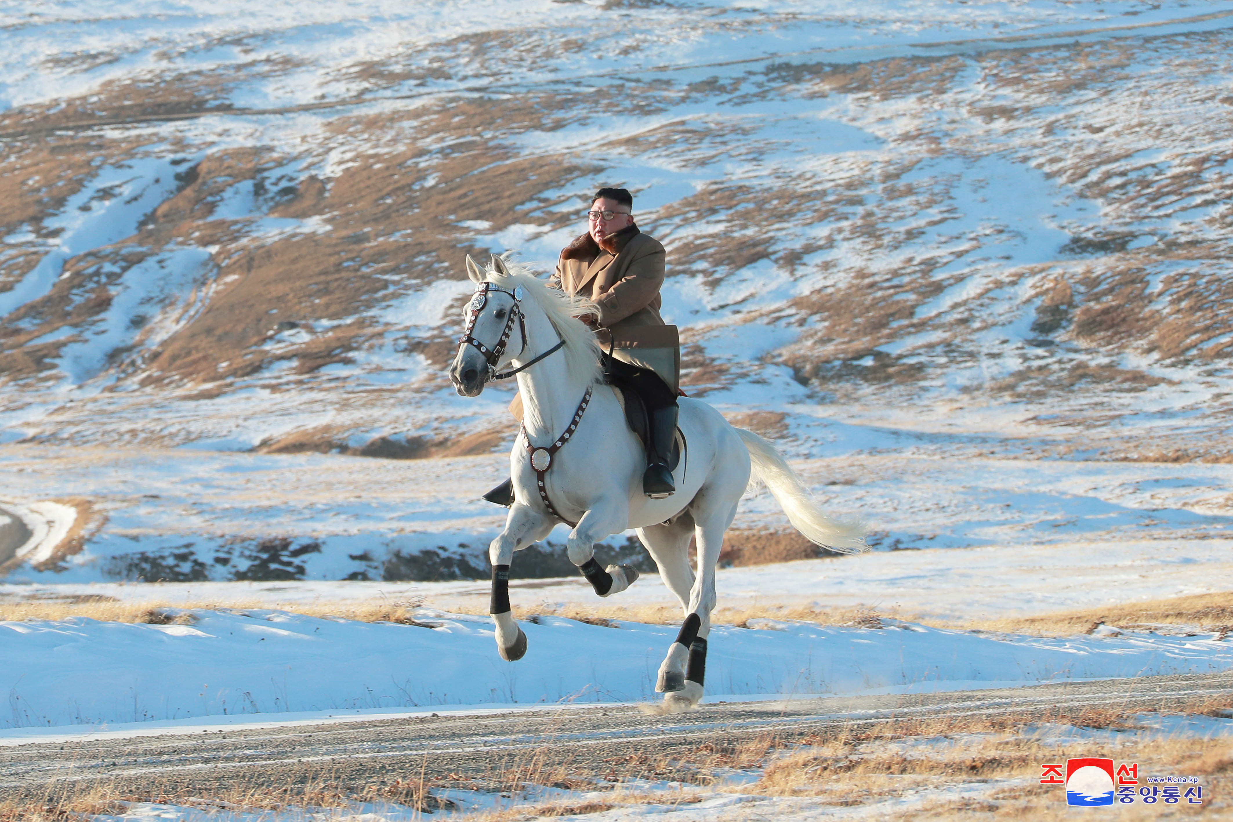 North Korean leader Kim Jong Un rides a horse during snowfall in Mount Paektu in this image released by North Korea's Korean Central News Agency (KCNA) on October 16, 2019. KCNA via REUTERS ATTENTION EDITORS - THIS IMAGE WAS PROVIDED BY A THIRD PARTY. REUTERS IS UNABLE TO INDEPENDENTLY VERIFY THIS IMAGE. NO THIRD PARTY SALES. SOUTH KOREA OUT.