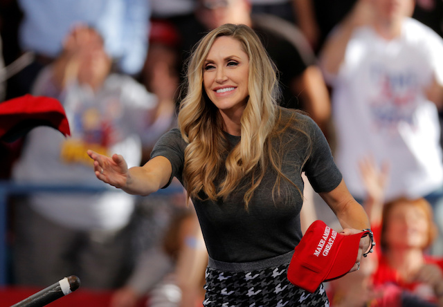 Lara Trump, daughter-in-law to Republican presidential nominee Donald Trump, tosses out hats to the crowd before Donald Trump speaks at a campaign rally in Raleigh, North Carolina November 7, 2016. REUTERS/Chris Keane