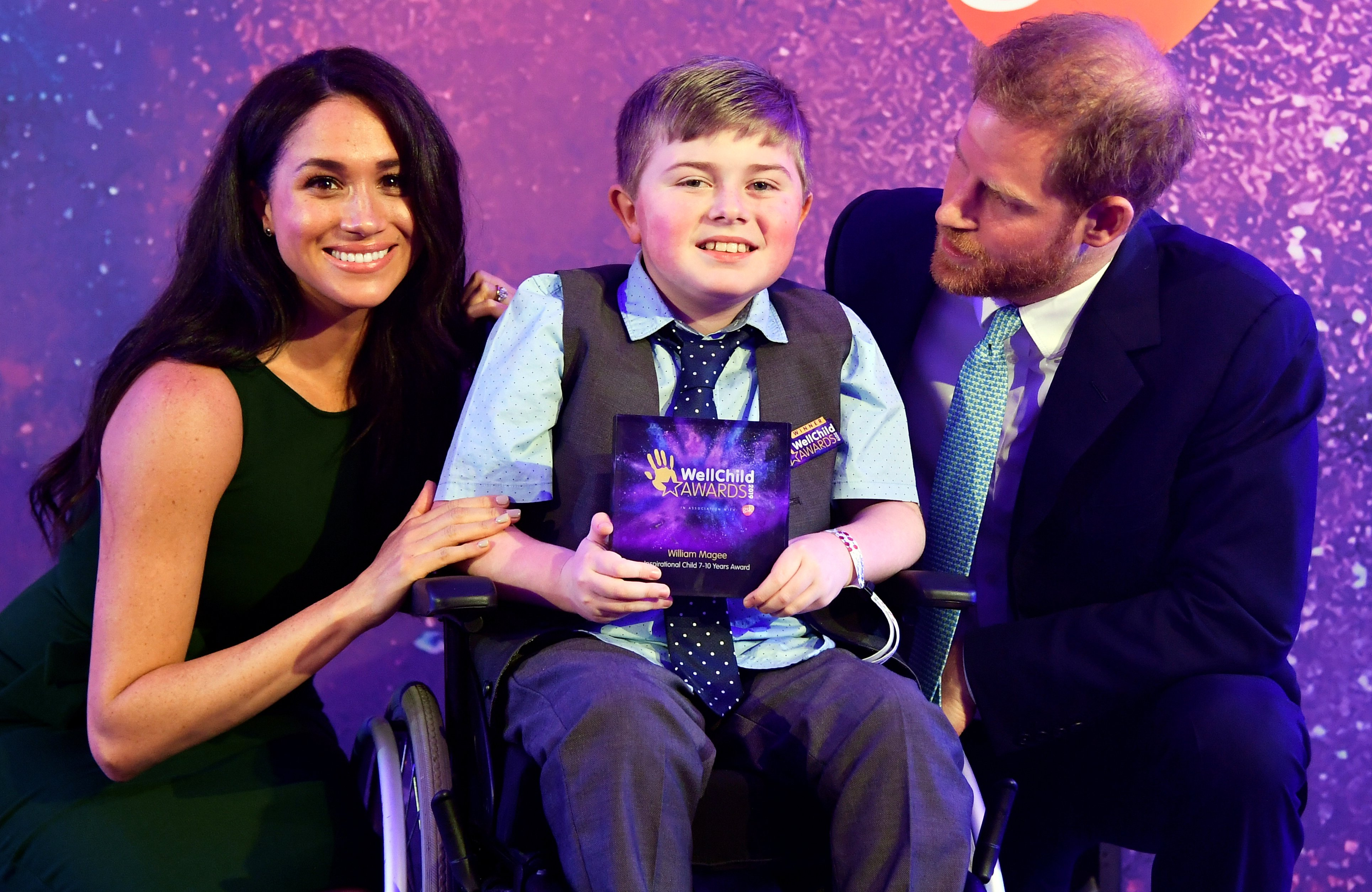 Prince Harry, Duke of Sussex and Meghan, Duchess of Sussex pose for a photograph with award winner William Magee during the WellChild Awards at Royal Lancaster Hotel on October 15, 2019 in London, England. (Photo by Toby Melville - WPA Pool/Getty Images)