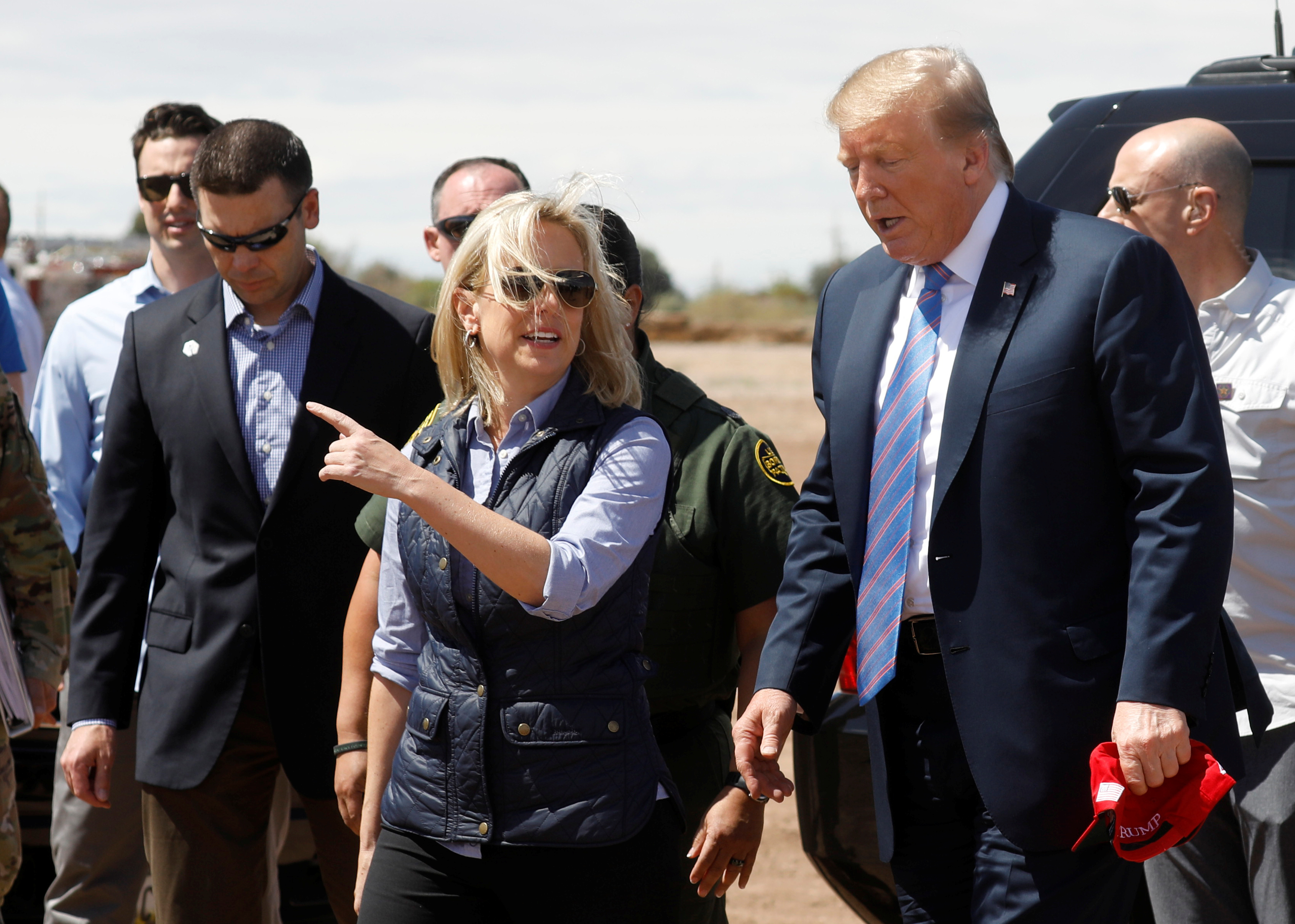 Nielsen and McAleenan walk with Trump at border security tour in California