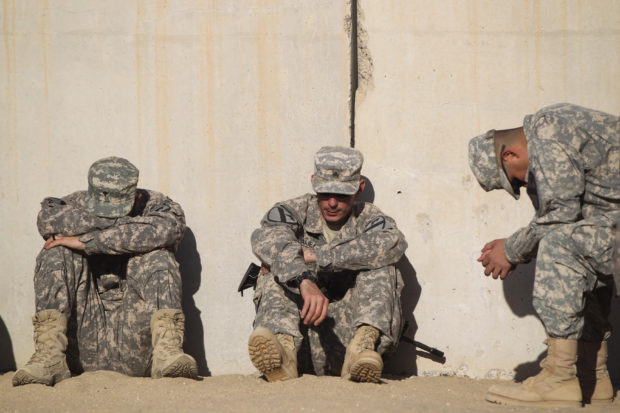 Soldiers from the 3rd Brigade Combat Team, 1st Cavalry Division rest while waiting to pack their weapons for shipment back to the United States at Camp Virginia, Kuwait December 19, 2011. The 3rd Brigade, 1st Cavalry Division was the last U.S. Military unit to depart Iraq and is processing to return to Fort Hood, Texas. REUTERS/Lucas Jackson