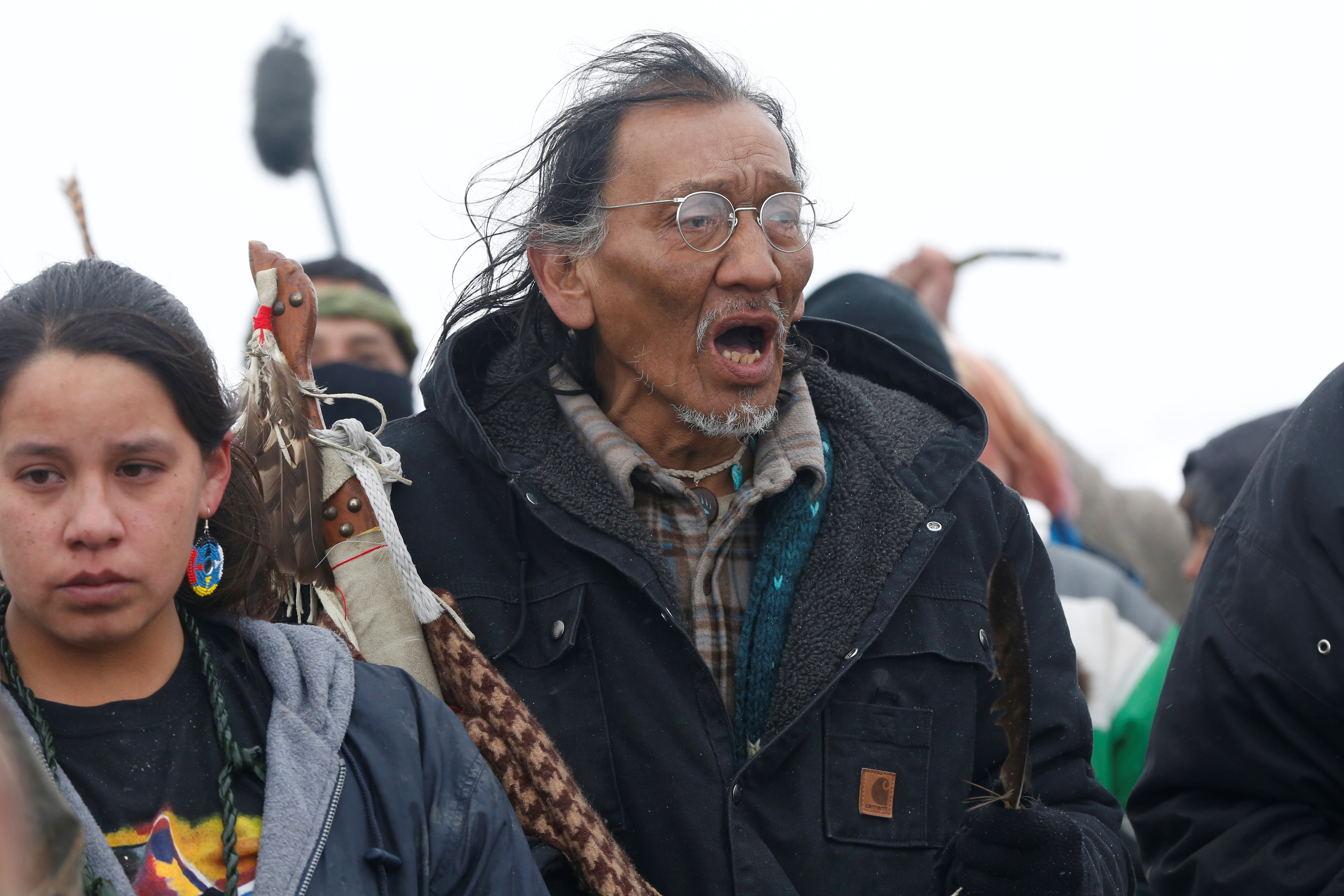 Nathan Phillips marches with other protesters out of the main opposition camp against the Dakota Access oil pipeline near Cannon Ball, North Dakota, U.S., February 22, 2017. (REUTERS/Terray Sylvester)