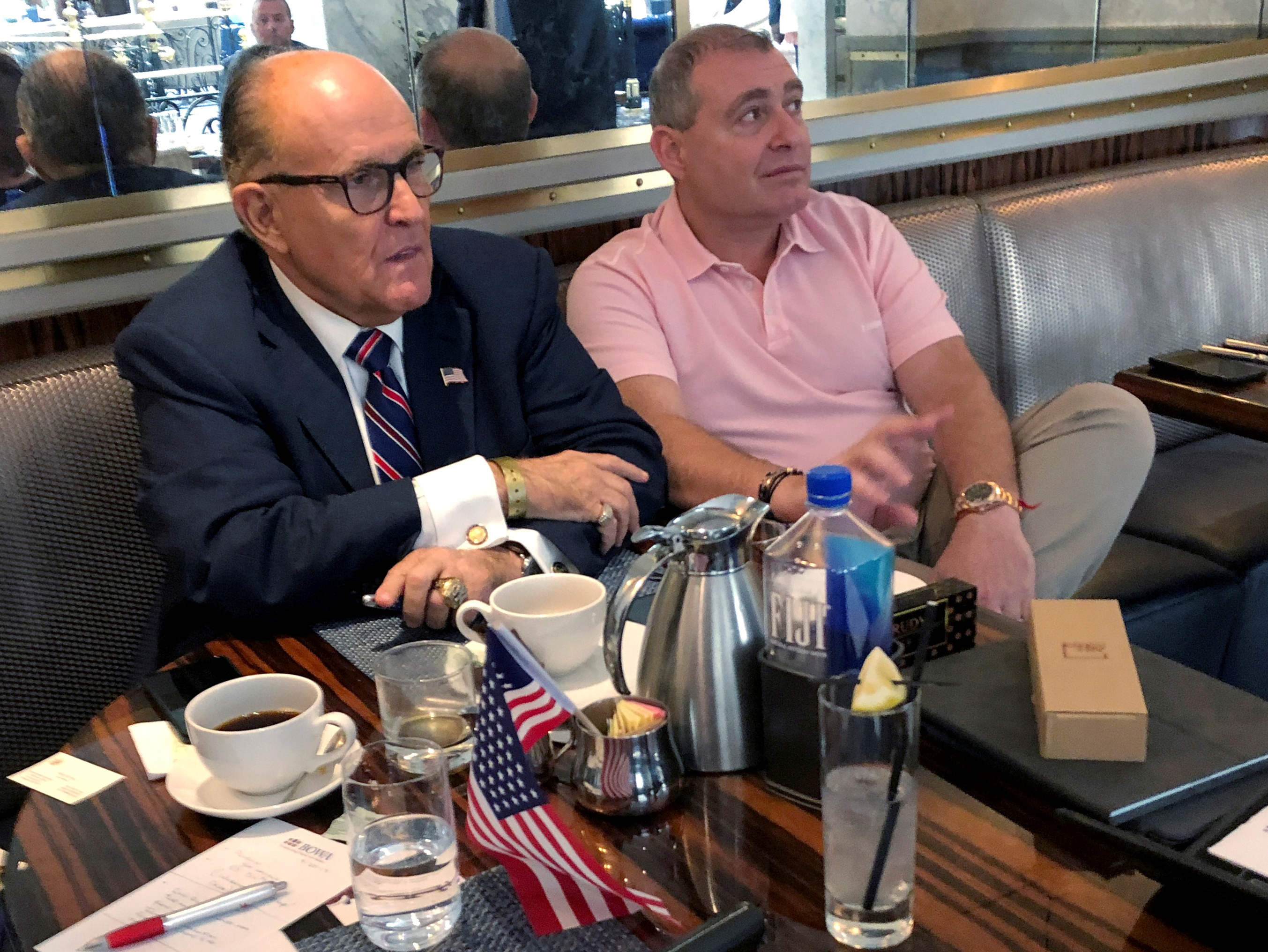 U.S. President Donald Trump's personal lawyer Rudy Giuliani has coffee with Ukrainian-American businessman Lev Parnas at the Trump International Hotel in Washington, U.S. September 20, 2019. (REUTERS/Aram Roston/File Photo)