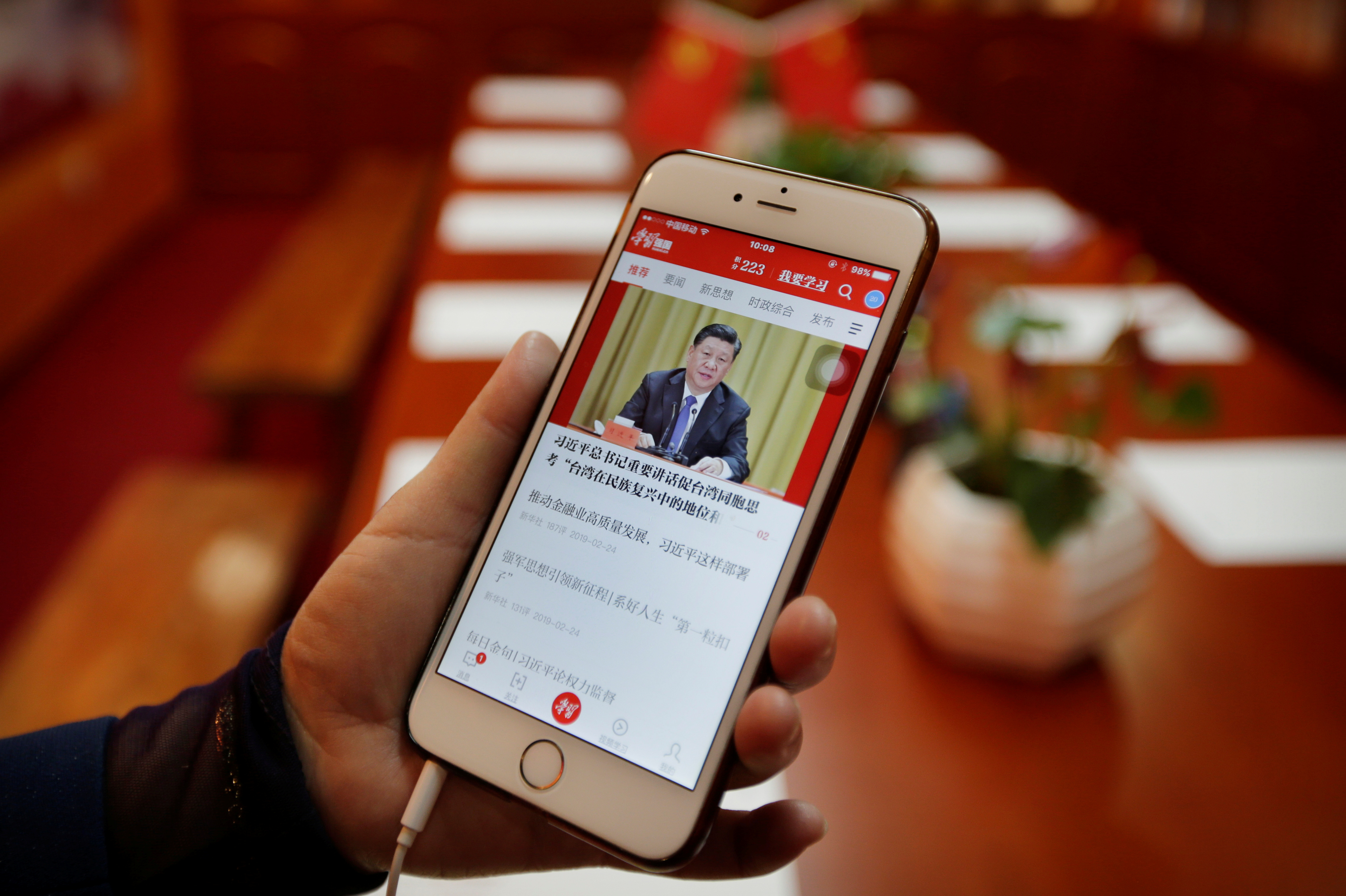 Cheng Hong, Tidal Star Group's communist party secretary, displays an app Xuexi Qiangguo, which literally translates as 'Study to make China strong', before a weekly group study at a party activity room in Beijing, China, February 25, 2019. Picture taken February 25, 2019. REUTERS/Jason Lee - RC1E7F620220