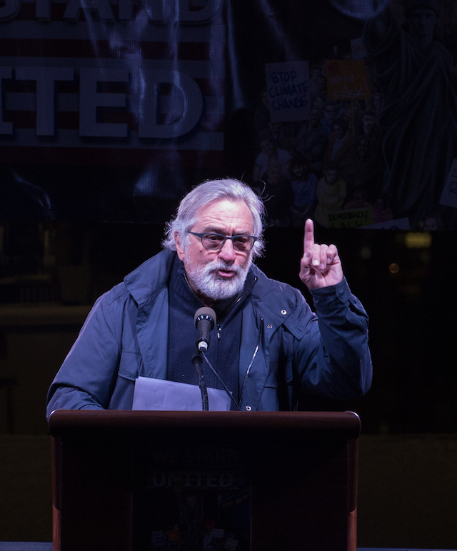 "Robert De Niro speaks at the ""We Stand United"" rally on the eve of U.S. President-elect Donald Trump's inauguration outside Trump International Hotel and Tower in New York on January 19, 2017 in New York. (Photo credit: BRYAN R. SMITH/AFP/Getty Images)"