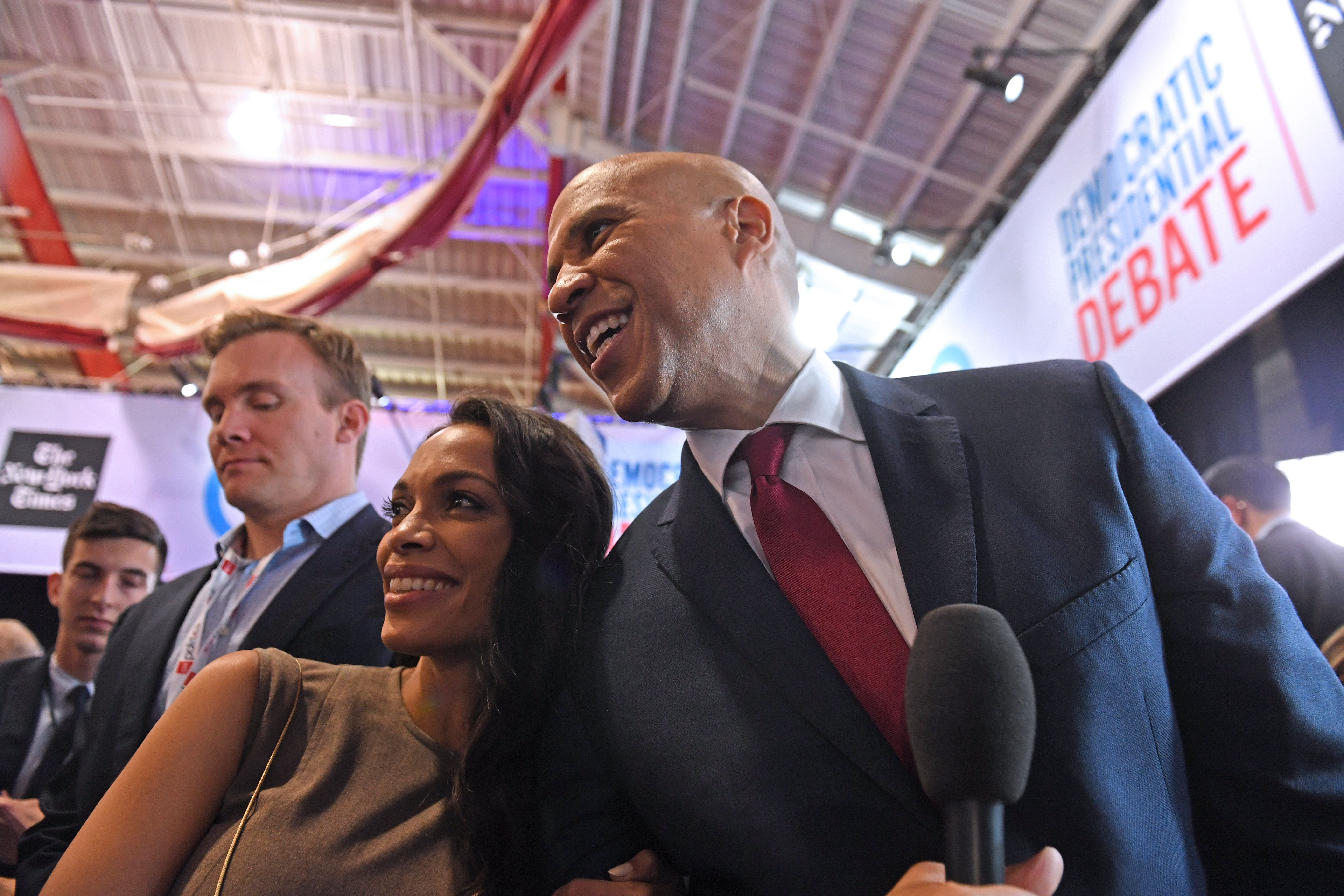 US actress Rosario Dawson (L) and boyfriend Democratic presidential hopeful New Jersey Senator Cory Booker pose for pictures in the spin room after the fourth Democratic primary debate of the 2020 presidential campaign season co-hosted by The New York Times and CNN at Otterbein University in Westerville, Ohio on October 15, 2019. (Photo by SAUL LOEB/AFP via Getty Images)
