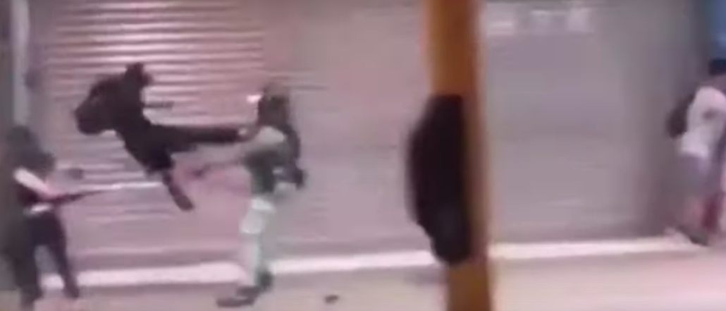 Video Shows Hong Kong Police Officer Getting Flying Kick To The Head