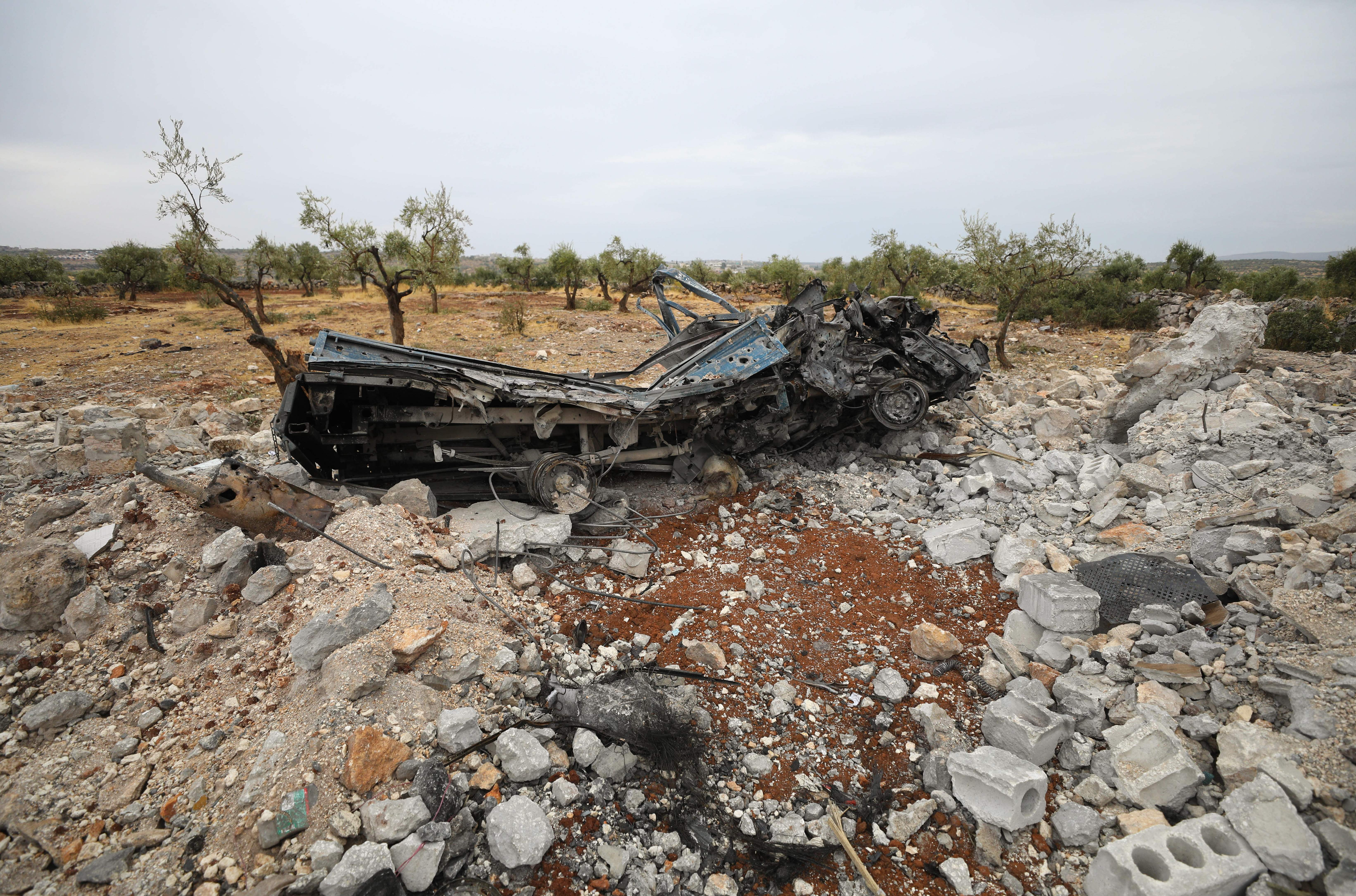 A picture taken on October 28, 2019 shows a vehicle wreck amid the rubble at the site of a suspected US-led operation against Islamic State (IS) chief Abu Bakr al-Baghdadi the previous day, on the edge of the small Syrian village of Barisha in the country's opposition-held northwestern Idlib province. - US President Donald Trump announced that Baghdadi, the elusive leader of the jihadist group and the world's most wanted man, was killed in the early hours of Octobe 27 in an overnight US raid near the village, located less than five kilometres from Turkey and controlled by the dominant jihadist group Hayat Tahrir al-Sham, an organisation that includes former operatives from Al-Qaeda's Syria affiliate. (Photo by Omar HAJ KADOUR / AFP) (Photo by OMAR HAJ KADOUR/AFP via Getty Images)
