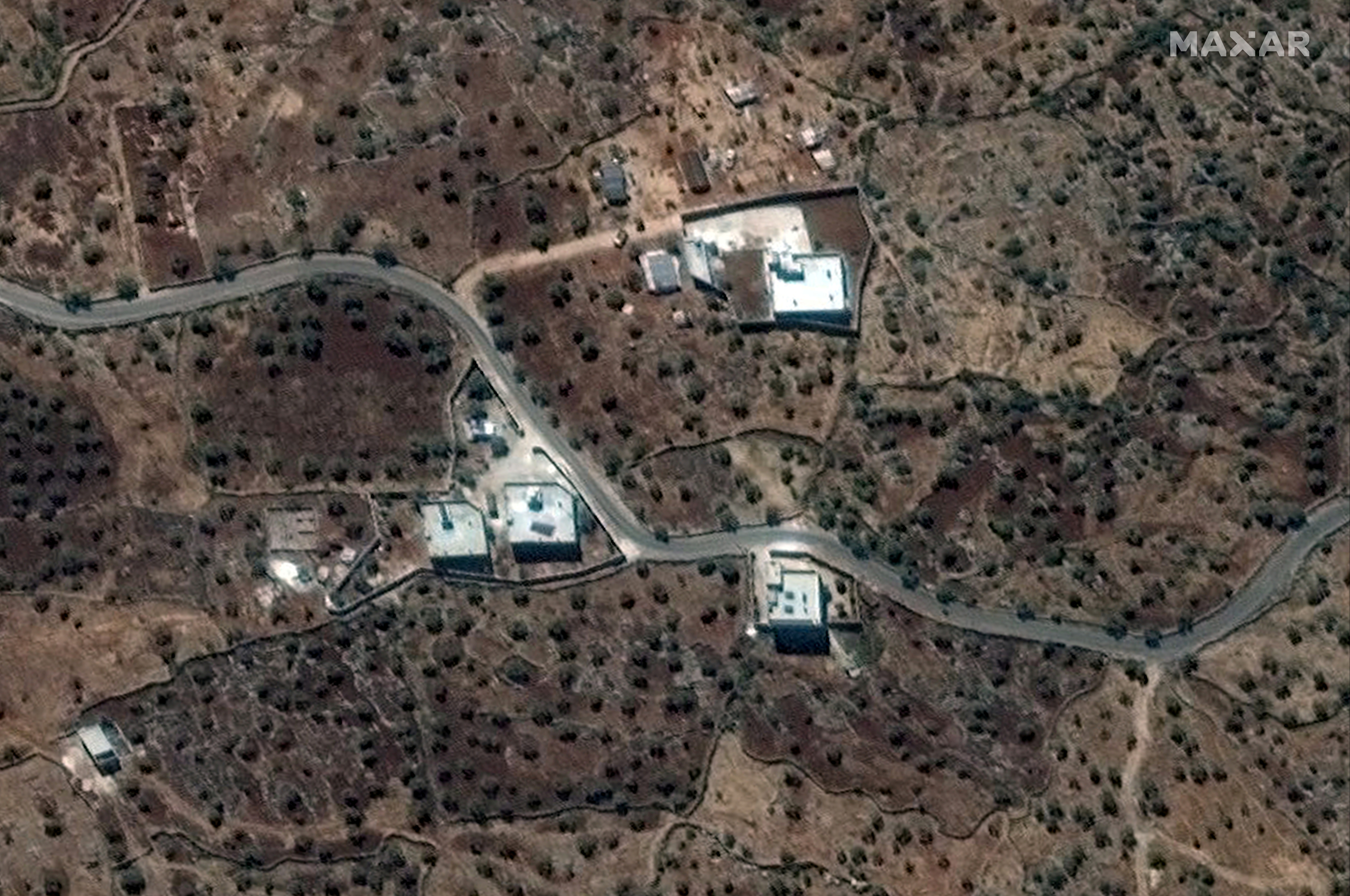 A satellite view of the reported residence of ISIS leader, Abu Bakr al-Baghdadi, according to the source, near the village of Barisha, Syria, collected on September 28, 2019, is shown in this handout image released on October 27, 2019 by Maxar Technologies. Maxar Technologies/Handout via REUTERS