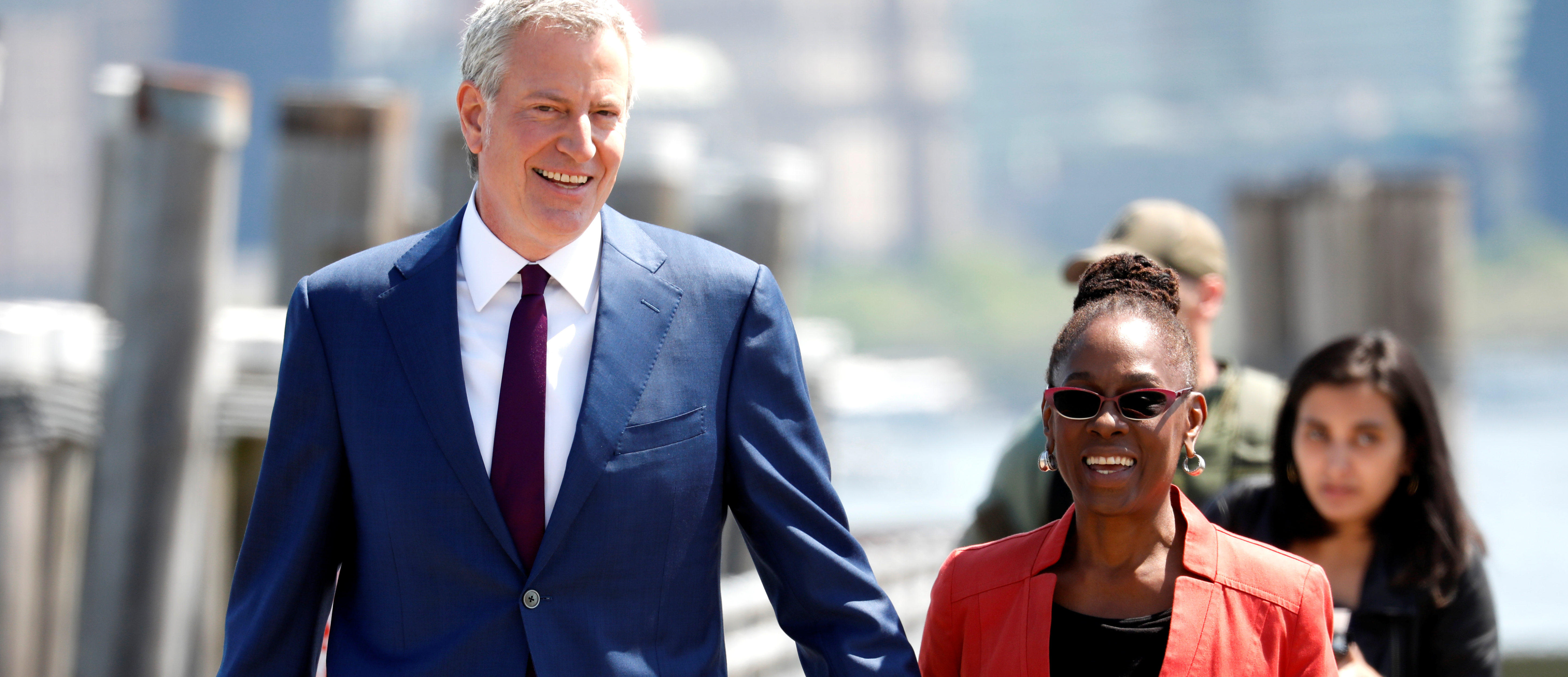 New York City Mayor and Democratic Presidential candidate Bill de Blasio arrives at Liberty Island with his wife Chirlane McCray to attend the dedication of the new Statue of Liberty Museum in New York Harbor, U.S., May 16, 2019. REUTERS/Mike Segar