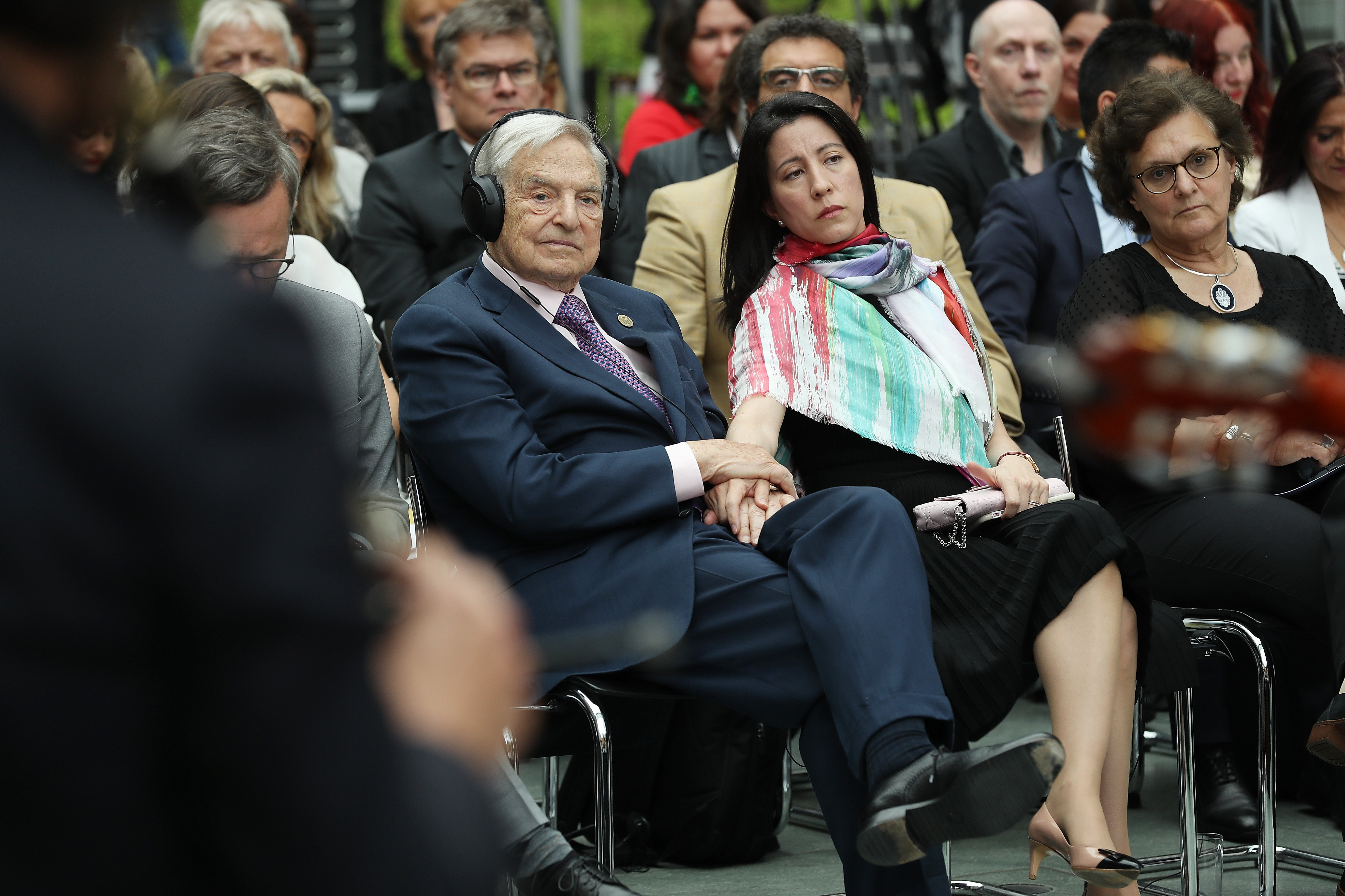 BERLIN, GERMANY - JUNE 08: Financier and philanthropist George Soros and his wife Tamiko Bolton attend the official opening of the European Roma Institute for Arts and Culture (ERIAC) at the German Foreign Ministry on June 8, 2017 in Berlin, Germany. The Institute, which is an initiative of the European Council, the Open Society Fund and the Alliance for the European Roma Institute for Arts and Culture, will have an administrative office in Berlin, gallery space in Venice and a liaison office in Brussels. (Photo by Sean Gallup/Getty Images)