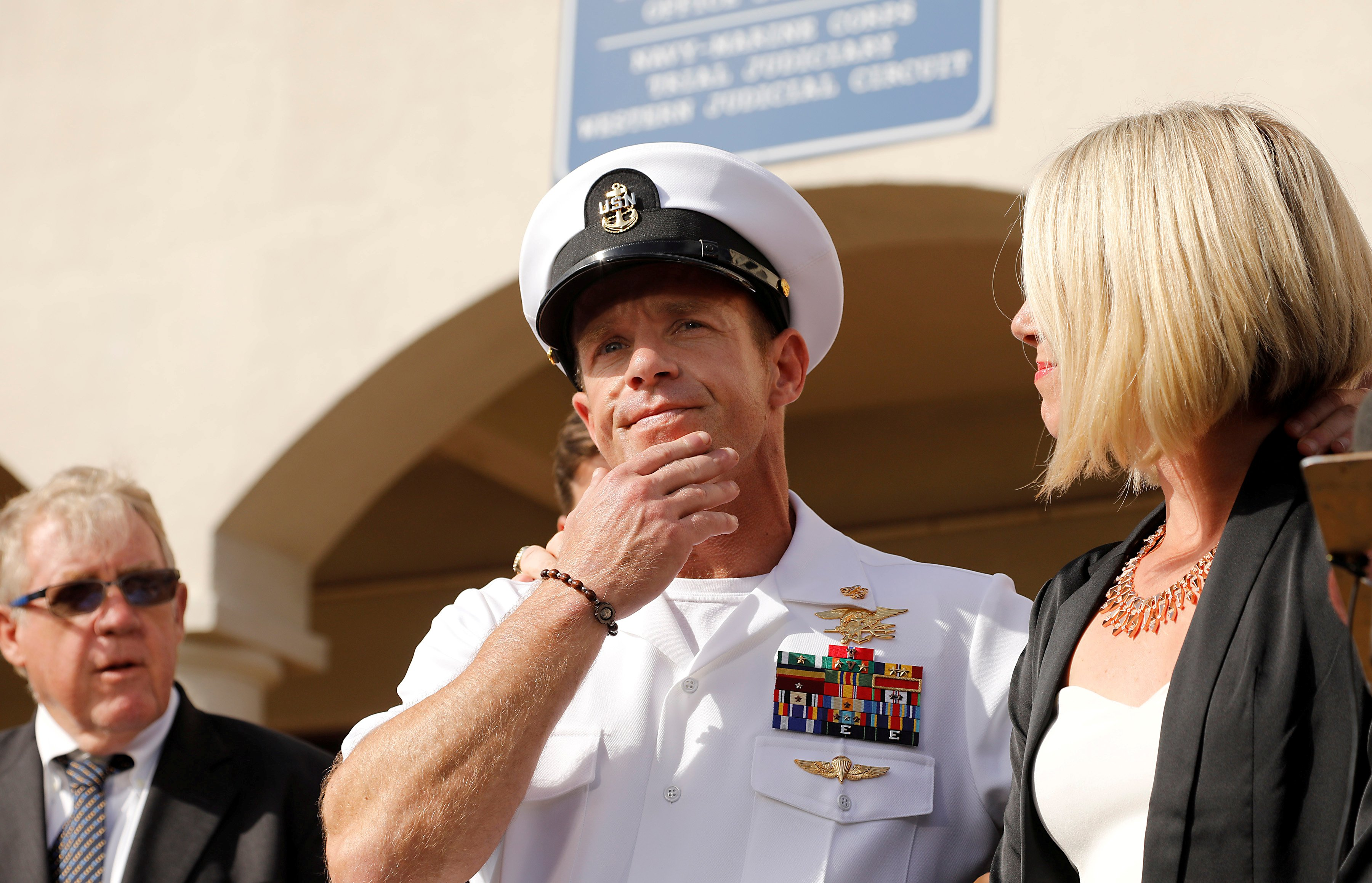 FILE PHOTO: U.S. Navy SEAL Special Operations Chief Edward Gallagher prepares to answer a question from the media with wife Andrea Gallagher after being acquitted on most of the serious charges against him during his court-martial trial at Naval Base San Diego in San Diego, California, U.S., July 2, 2019. REUTERS/John Gastaldo/File Photo