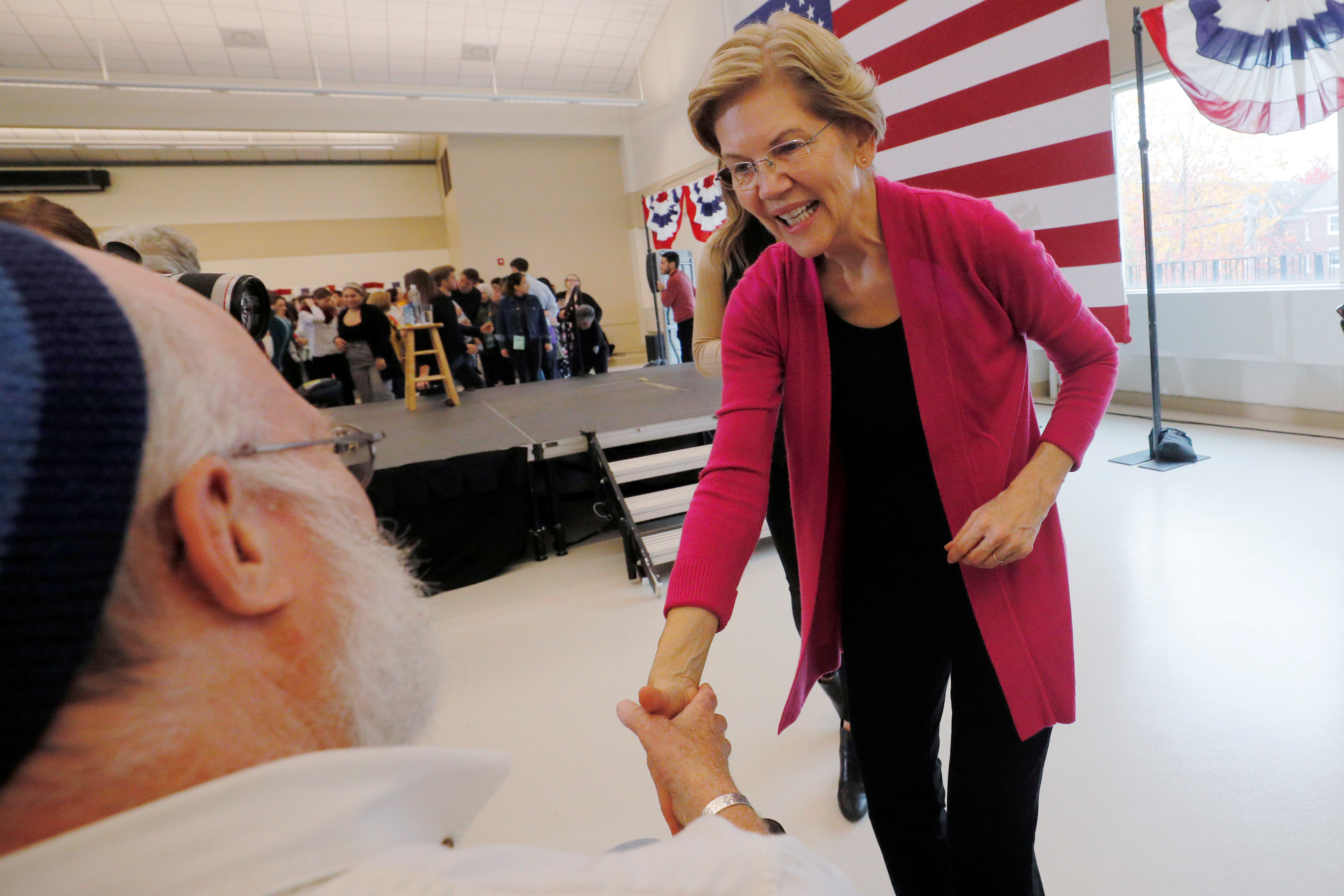 Democratic 2020 U.S. presidential candidate and U.S. Senator Elizabeth Warren (D-MA) greets audience members at a campaign town hall meeting at the University of New Hampshire in Durham, New Hampshire, U.S., October 30, 2019. REUTERS/Brian Snyder