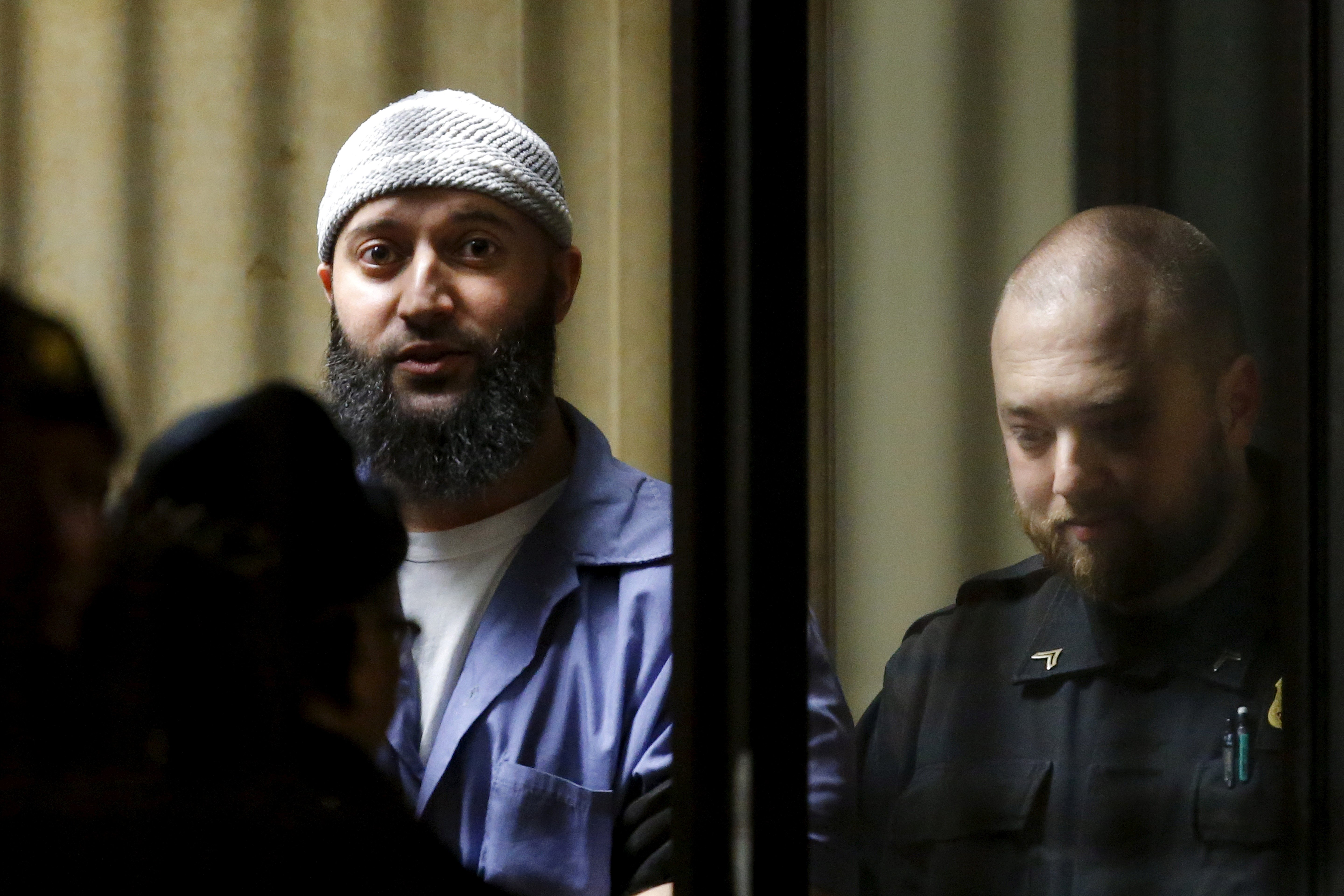 Convicted murderer Adnan Syed leaves the Baltimore City Circuit Courthouse on February 5, 2016. (Reuters/Carlos Barria)