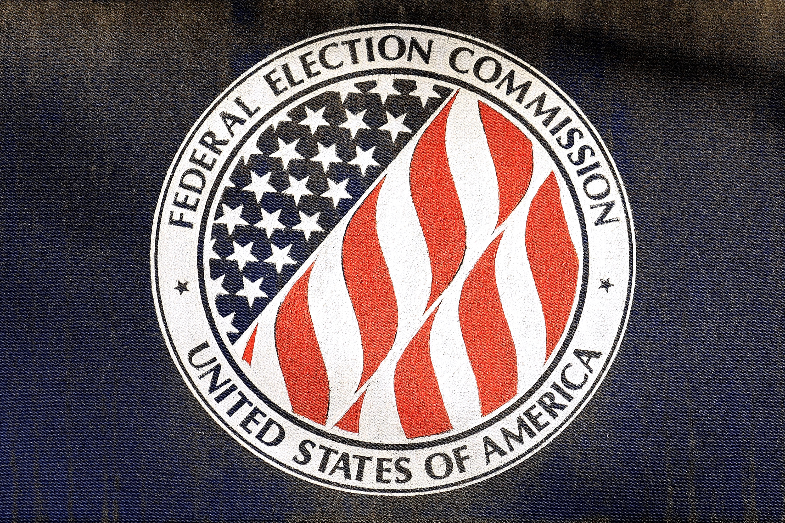 The seal of the Federal Election Commission is printed on window awnings outside its headquarters Oct. 24, 2016 in Washington, D.C. (Photo by Chip Somodevilla/Getty Images)