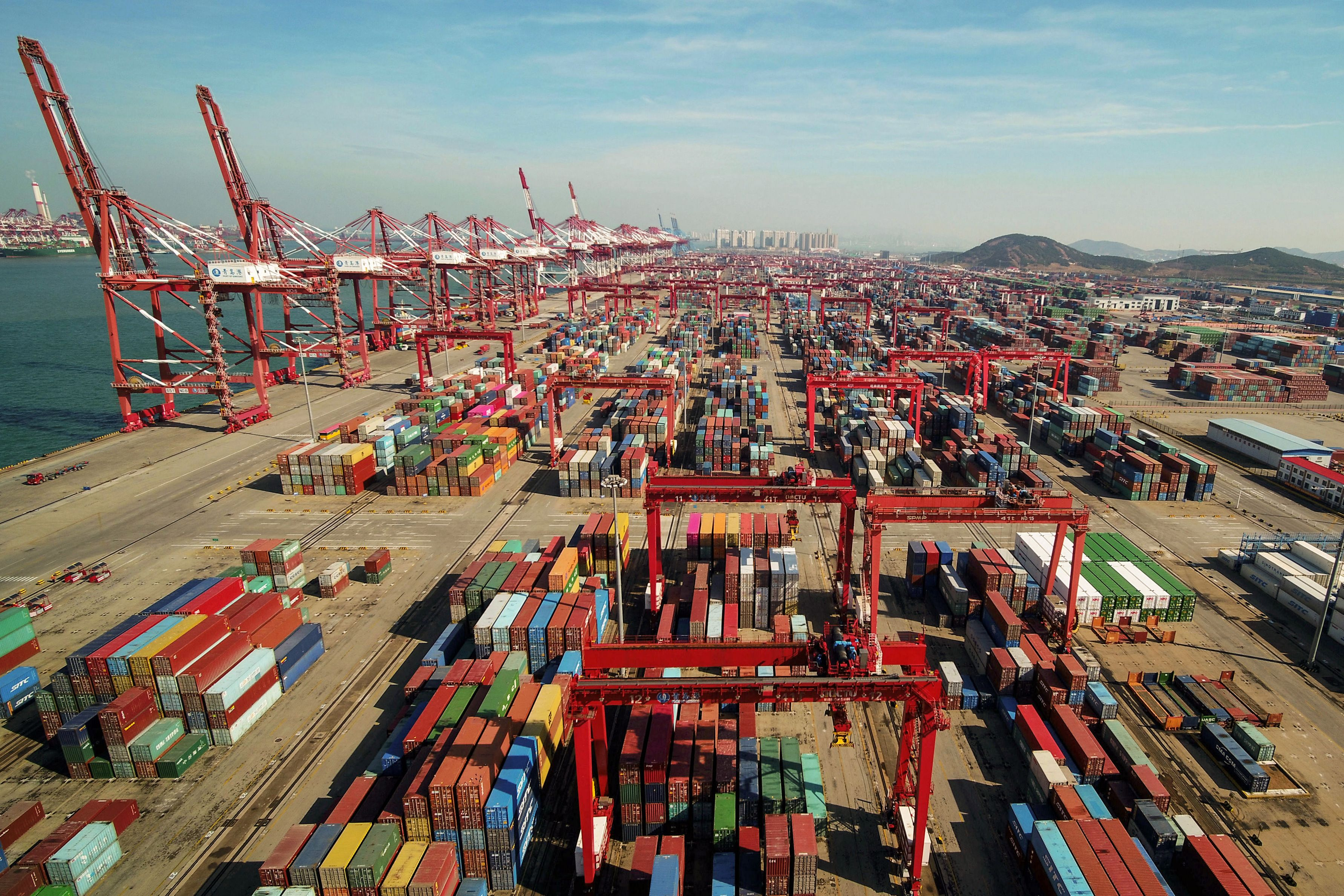 An aerial view of a port in Qingdao, east China's Shandong province on November 8, 2018. - China's exports to the US and the rest of the world grew more than expected in October, official data showed on November 8, as its traders apparently rushed shipments across the Pacific ahead of higher tariffs. / STR/AFP via Getty Images