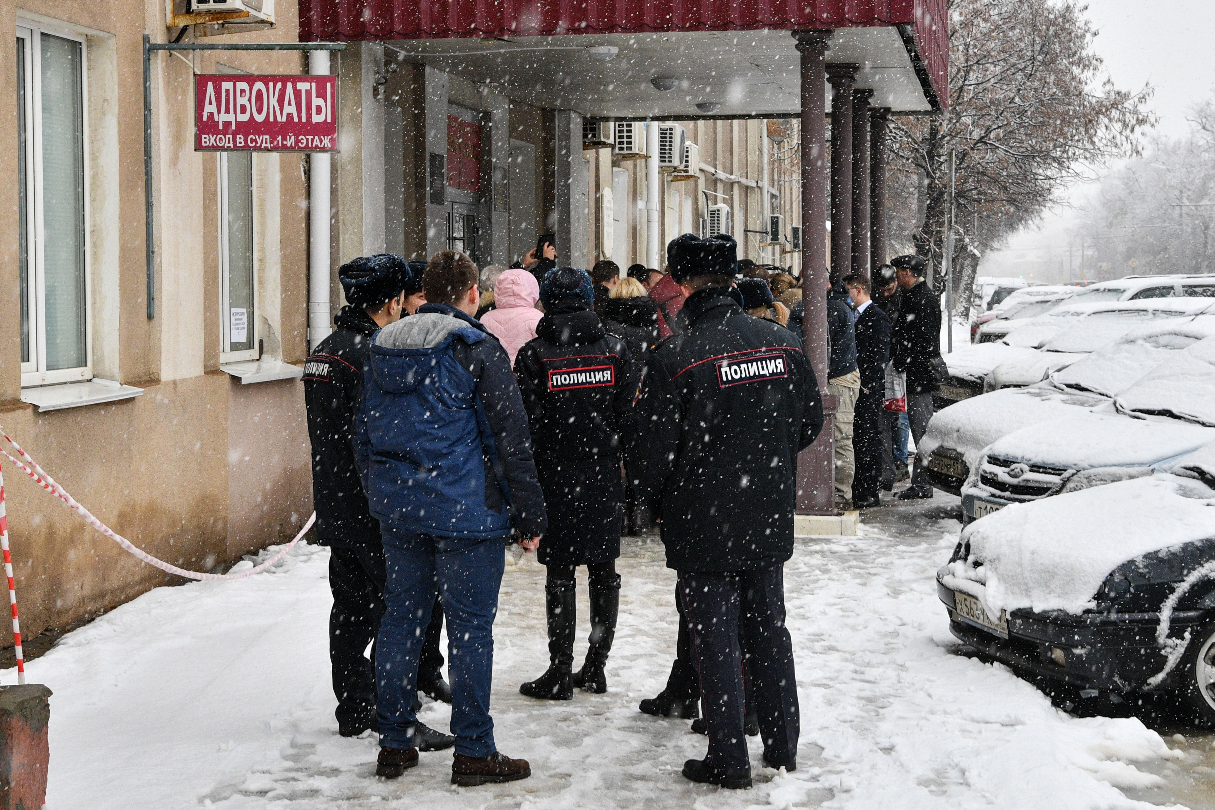 "Members of the media and supporters of Dennis Christensen gather outside a courthouse after the verdict announcement in his trial in the town of Oryol on February 6, 2019. - A Russian court on February 6, 2019 sentenced a Danish Jehovah's Witness to six years in prison for ""extremism"", in the first conviction of its kind since a 2017 law that outlawed the religious group. (Photo by Mladen ANTONOV / AFP) (Photo credit should read MLADEN ANTONOV/AFP via Getty Images)"