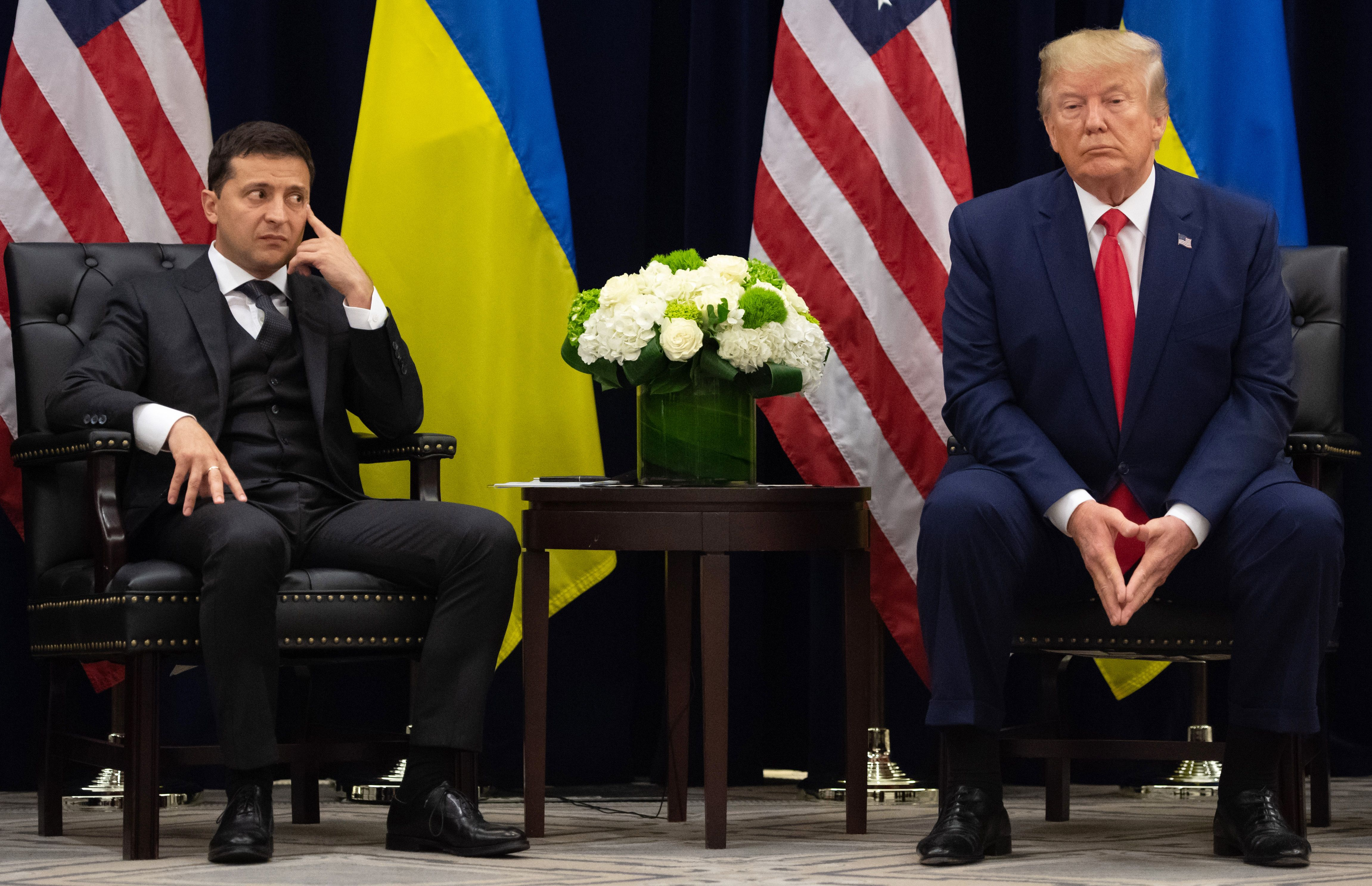 TOPSHOT - US President Donald Trump and Ukrainian President Volodymyr Zelensky looks on during a meeting in New York on September 25, 2019, on the sidelines of the United Nations General Assembly. (Photo by SAUL LOEB / AFP) (Photo by SAUL LOEB/AFP via Getty Images)