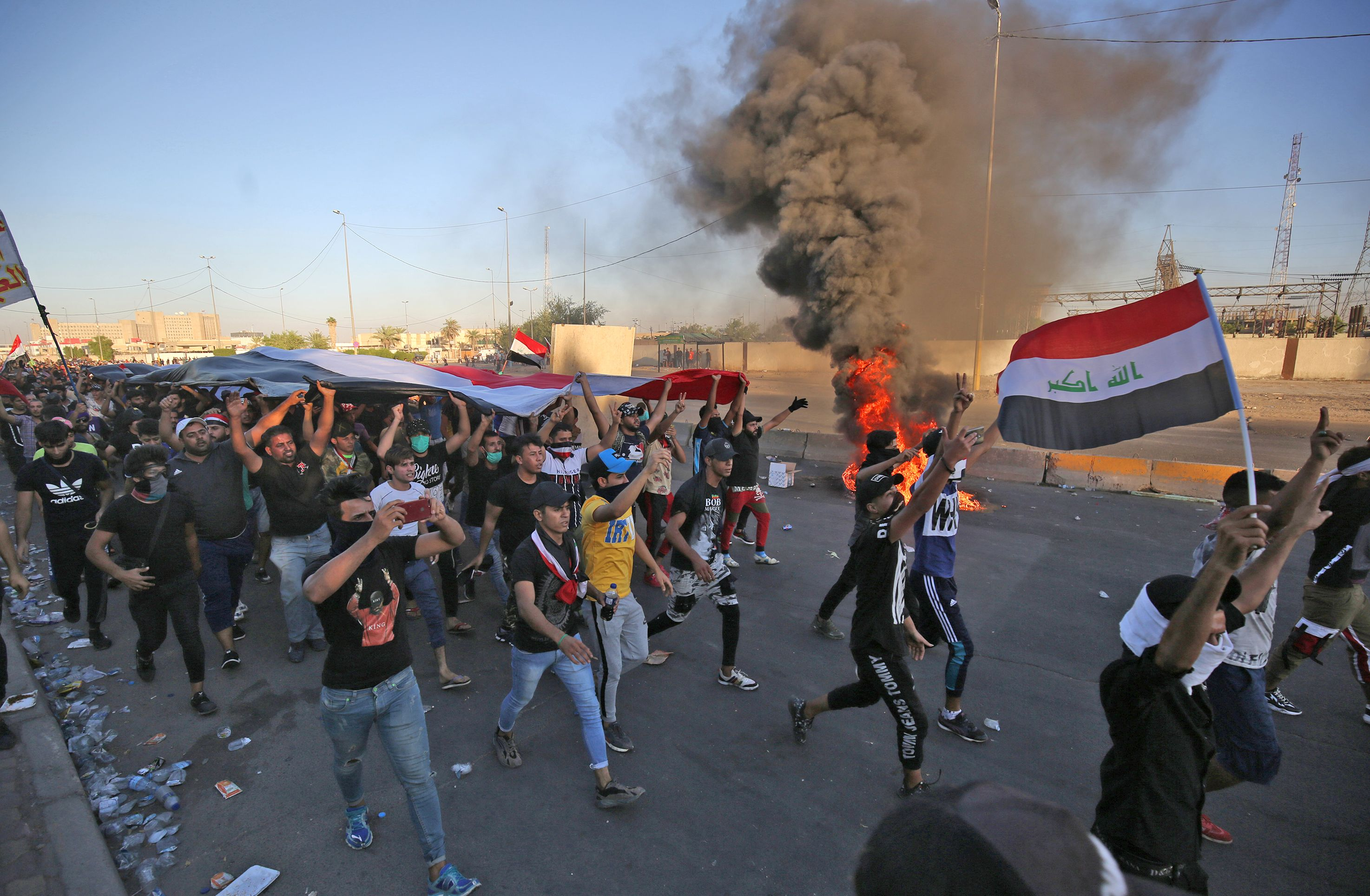 Iraqi protesters take part in a demonstration against state corruption, failing public services, and unemployment, in the Iraqi capital Baghdad's central Khellani Square on October 4, 2019. (AHMAD AL-RUBAYE/AFP via Getty Images)