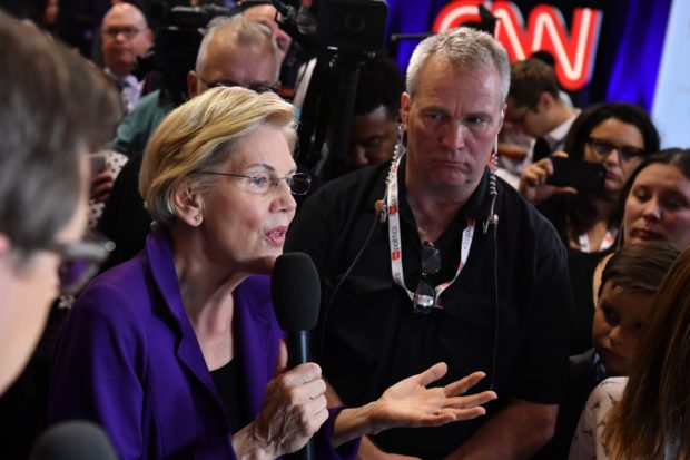 Democratic presidential hopeful Massachusetts Senator Elizabeth Warren speaks to the press in the spin room during the fourth Democratic primary debate of the 2020 presidential campaign season co-hosted by The New York Times and CNN at Otterbein University in Westerville, Ohio on October 15, 2019. (Photo by NICHOLAS KAMM/AFP via Getty Images)
