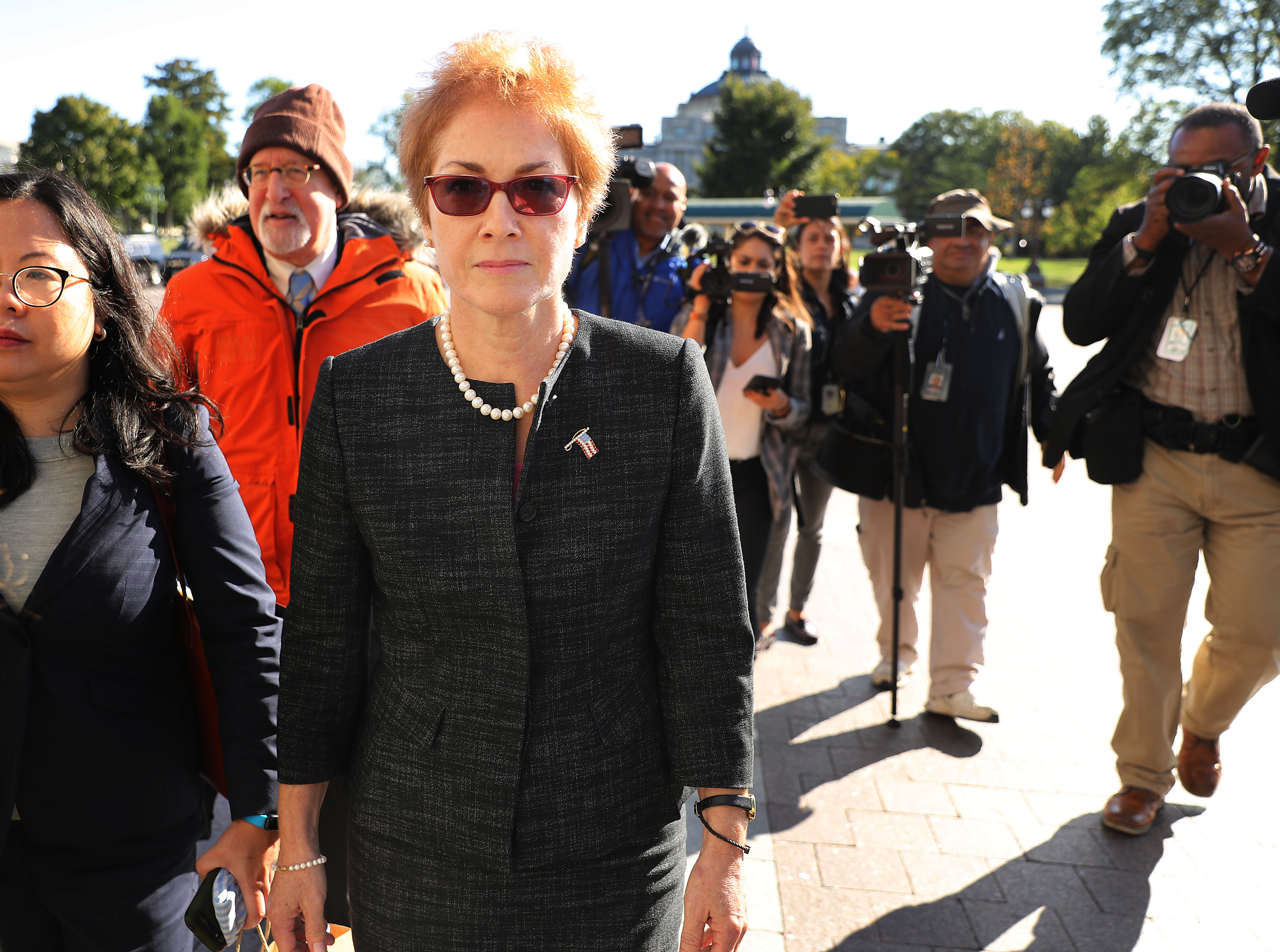 Former U.S. Ambassador to Ukraine Marie Yovanovitch (C) is surrounded by lawyers, aides and journalists as she arrives at the U.S. Capitol October 11, 2019 in Washington, DC. (Chip Somodevilla/Getty Images)
