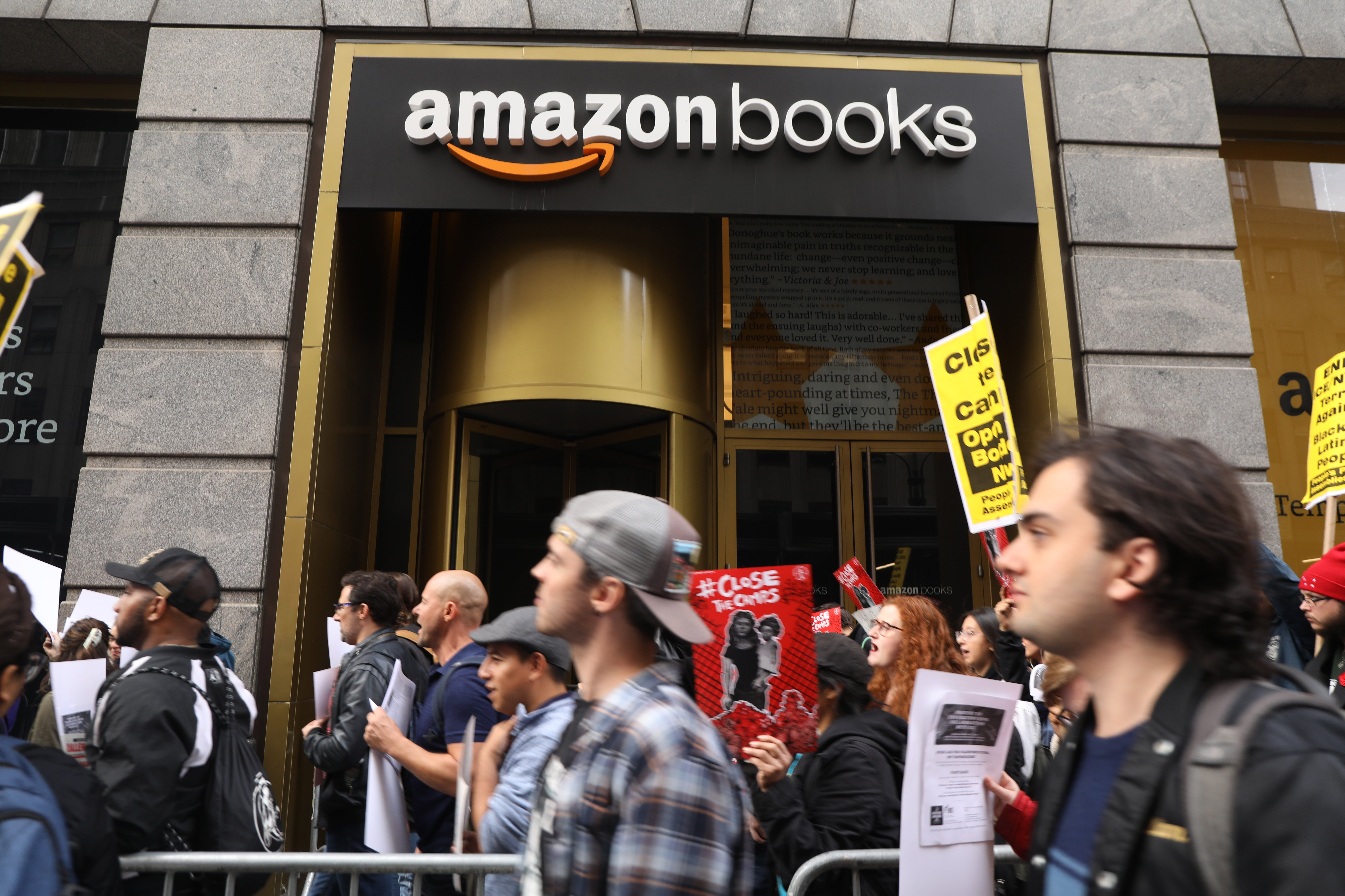 NEW YORK, NEW YORK - OCTOBER 11: Immigrant rights protesters participate in a demonstration to draw attention to tech companies involvement in the immigration enforcement system on October 11, 2019 in New York City. The activists walked and demonstrated in front of an Amazon store and the offices of Salesfore, two tech companies that have worked in various capacities with Immigration and Custom Enforcement (ICE). (Photo by Spencer Platt/Getty Images)