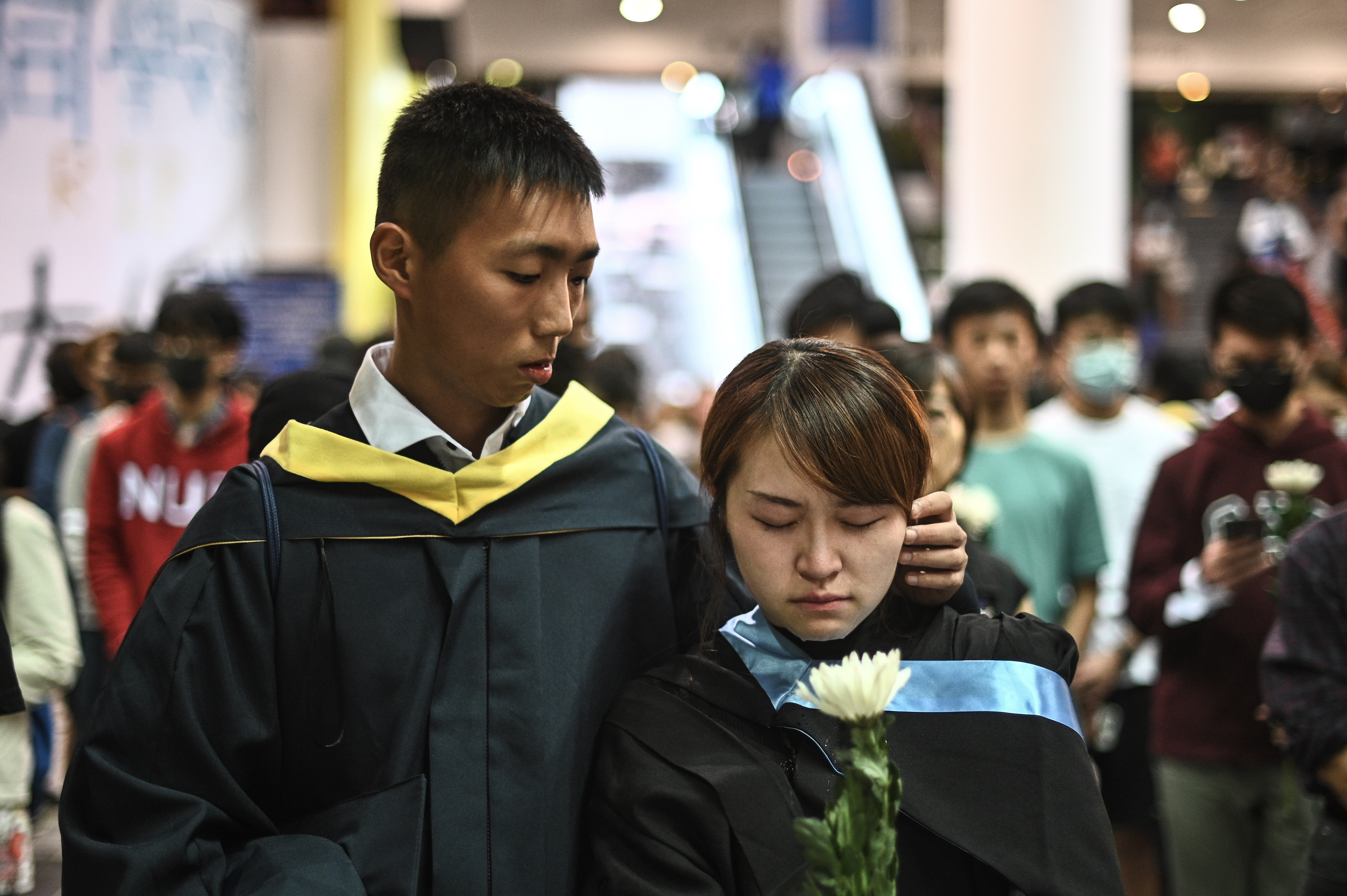 Students take part in a vigil at the Hong Kong University of Science and Technology (HKUST) in Hong Kong on November 8, 2019 for student Alex Chow, 22, who died earlier in the day after he was taken unconscious to hospital early on November 4 following late-night clashes between police and protesters.(PHILIP FONG/AFP via Getty Images)