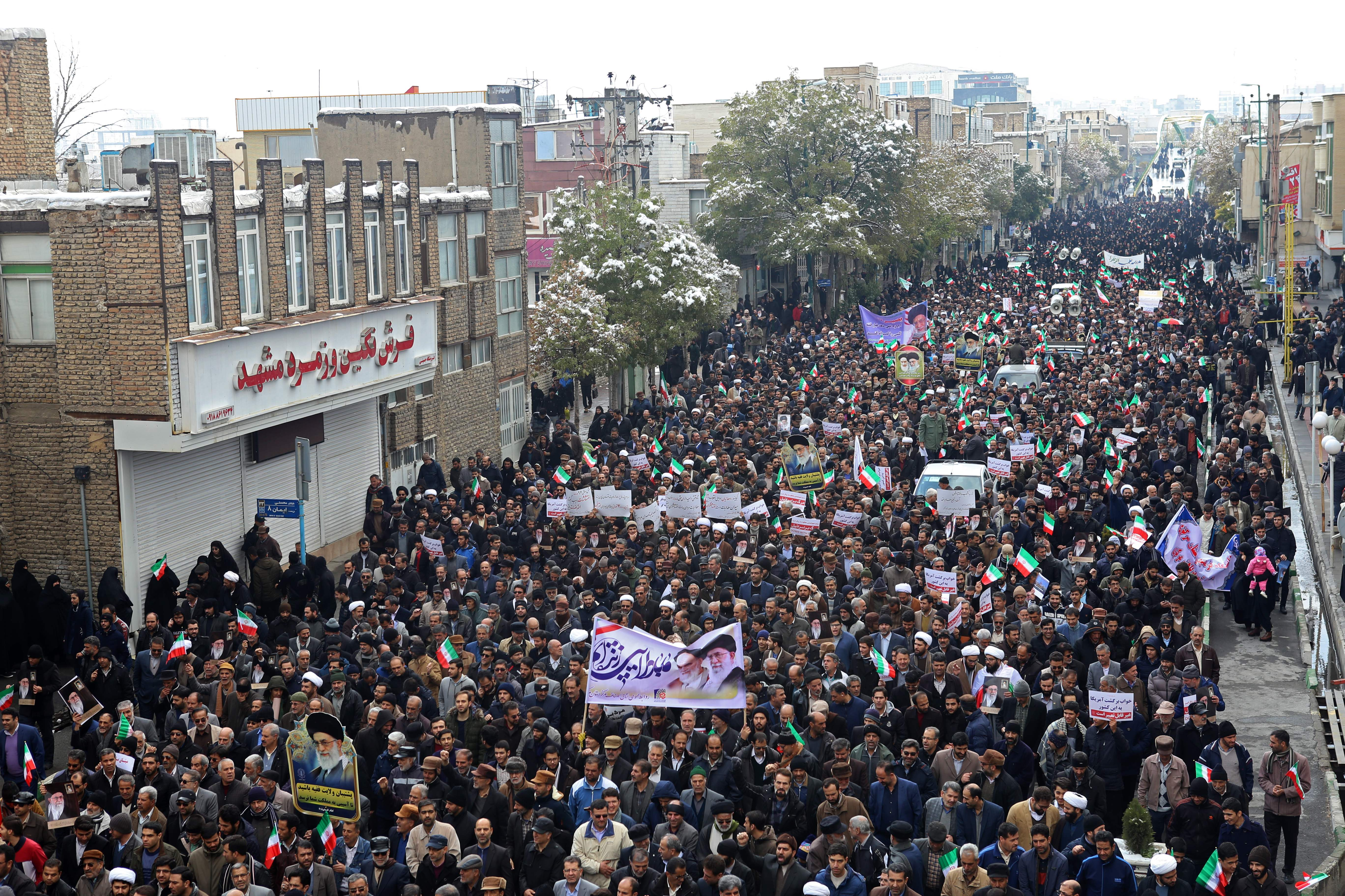 "Iranians take to the streets in support of the Islamic republic's government and supreme leader, Ayatollah Ali Khamenei, in the cenral city of Arak, southwest of the capital Tehran, on November 20, 2019, as President Hassan Rouhani said the country's people had defeated an ""enemy conspiracy"" behind a wave of violent street protests. - Demonstrations erupted in sanctions-hit Iran last week after an announcement the price of petrol would be raised by as much as 200 percent, with motorists blocking major roads in Tehran before the unrest spread rapidly to at least 40 urban centres, with petrol pumps torched, police stations attacked and shops looted. (Photo by STR / AFP) (Photo by STR/AFP via Getty Images)"