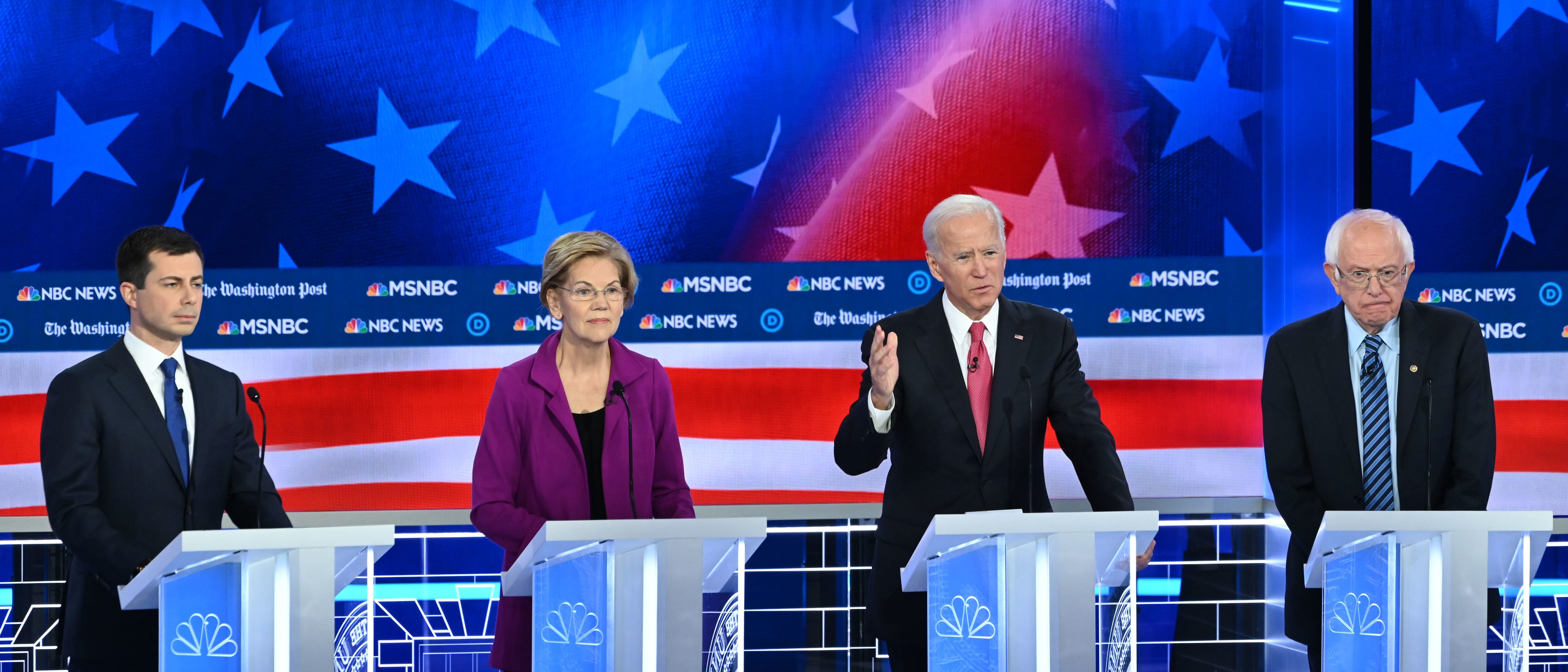 Democratic presidential hopefuls (L-R) Mayor of South Bend, Indiana, Pete Buttigieg, Massachusetts Senator Elizabeth Warren, Former Vice President Joe Biden and Vermont Senator Bernie Sanders speak during the fifth Democratic primary debate of the 2020 presidential campaign season. (SAUL LOEB/AFP via Getty Images)