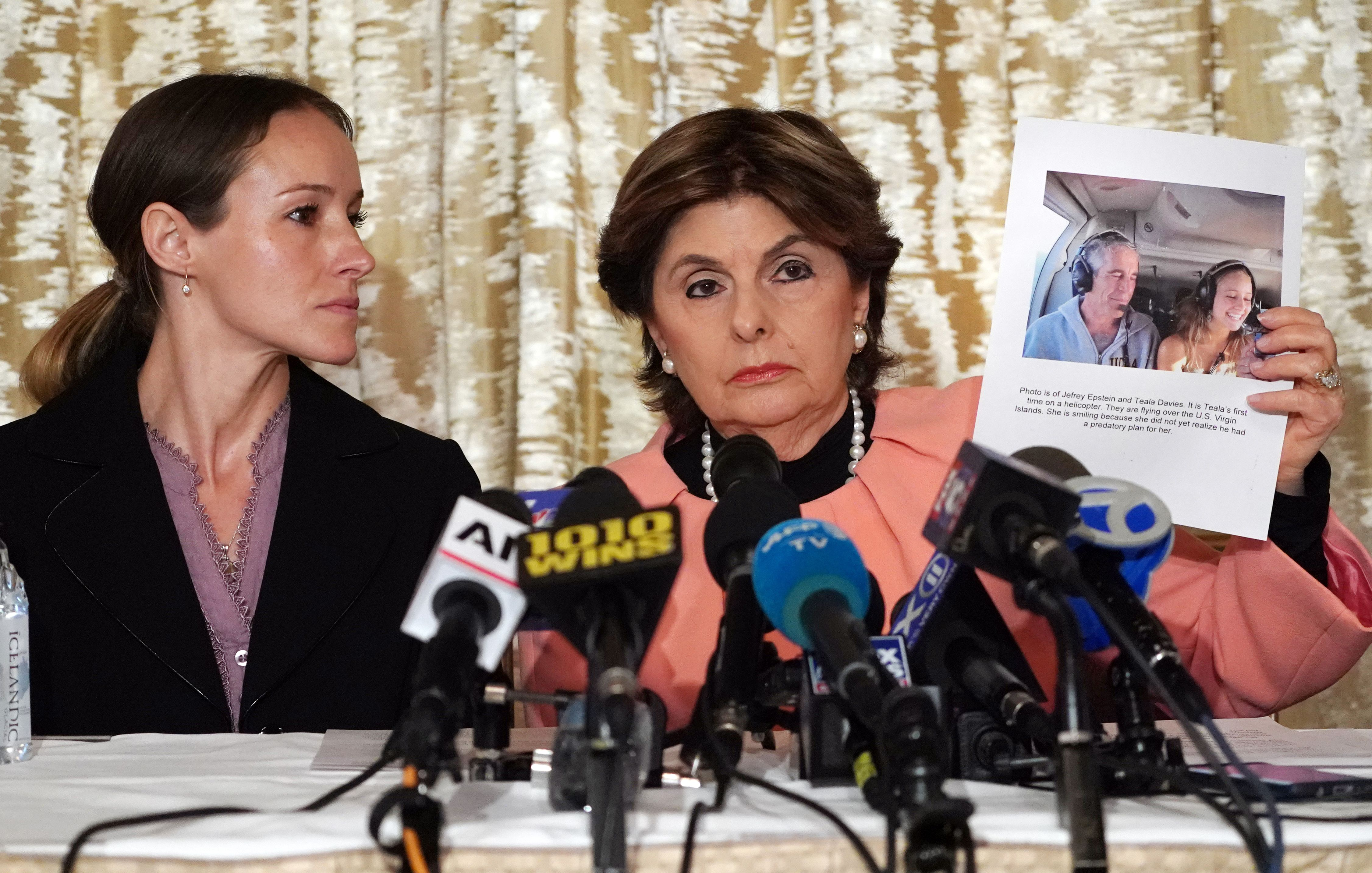Attorney Gloria Allred (R) and her client Teala Davies, who claims to be a victim of sexual abuse by Jeffrey Epstein when she was a minor, hold a press conference in New York City. (TIMOTHY A. CLARY/AFP via Getty Images)