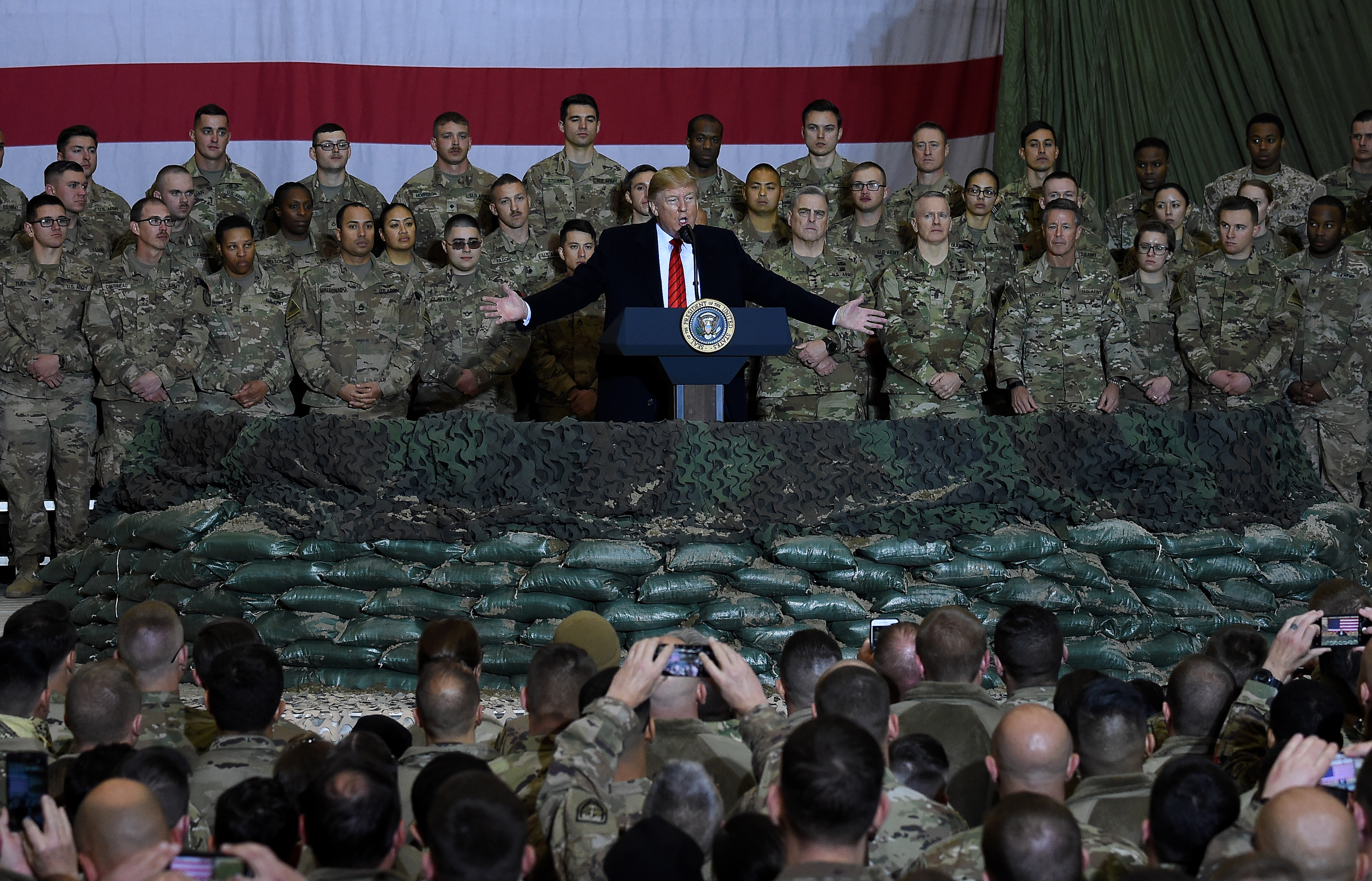 TOPSHOT - US President Donald Trump speaks to the troops during a surprise Thanksgiving day visit at Bagram Air Field, on November 28, 2019 in Afghanistan. (Photo by Olivier Douliery / AFP) (Photo by OLIVIER DOULIERY/AFP via Getty Images)